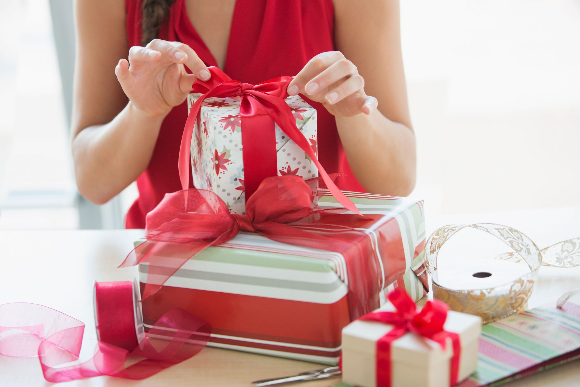 Woman Wrapping Christmas Gifts