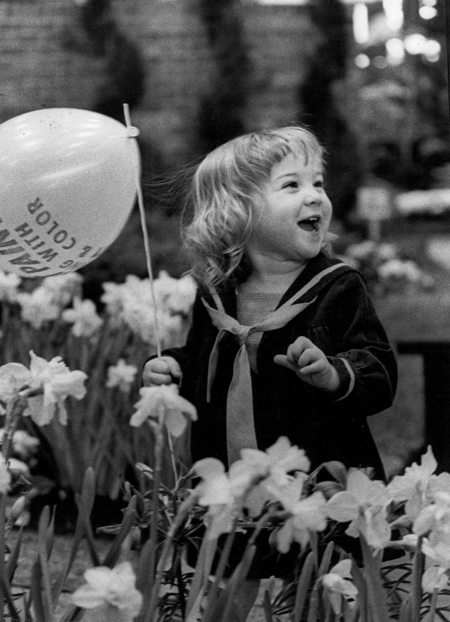 Baby Playing in Flowers with Balloon