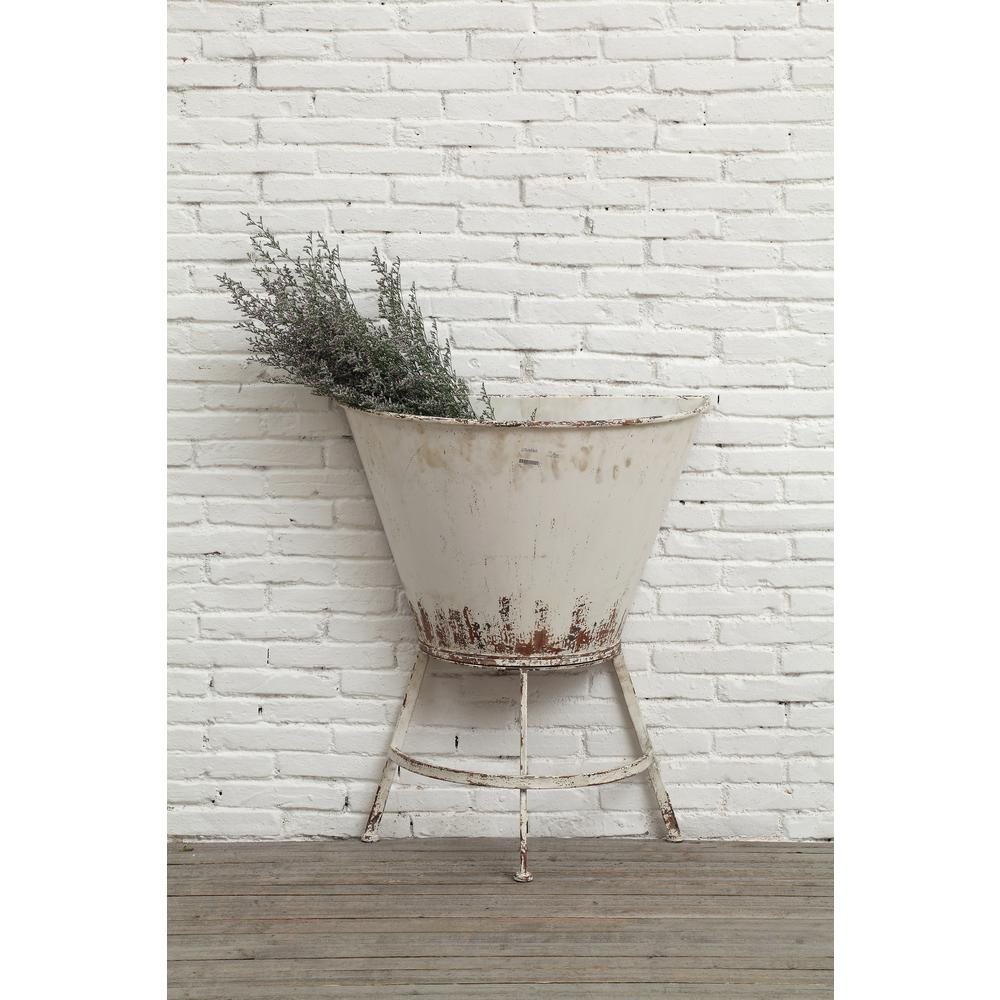 White metal wall flower planter