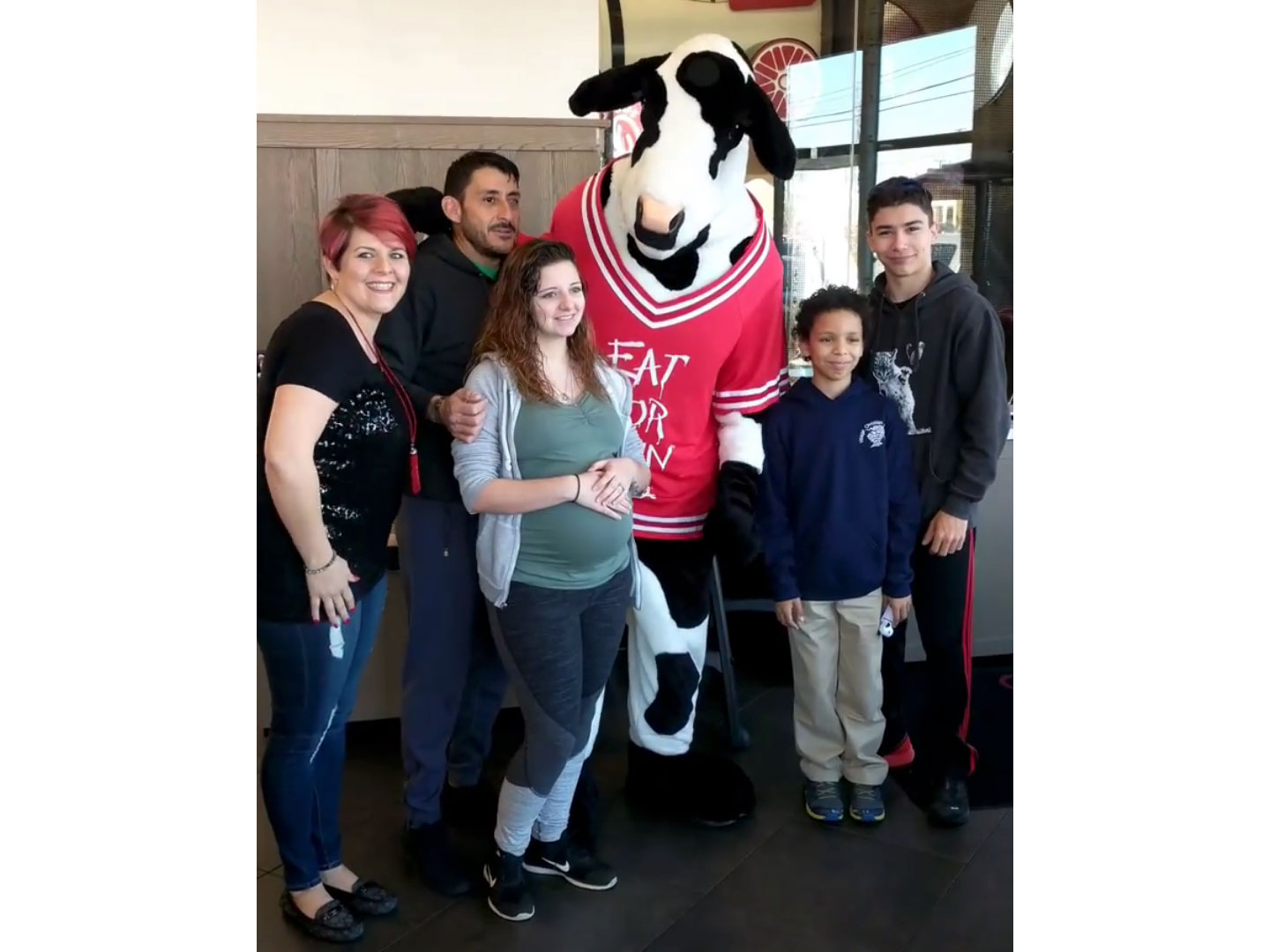 Soldier Dressed in Chick-fil-a Cow Costume