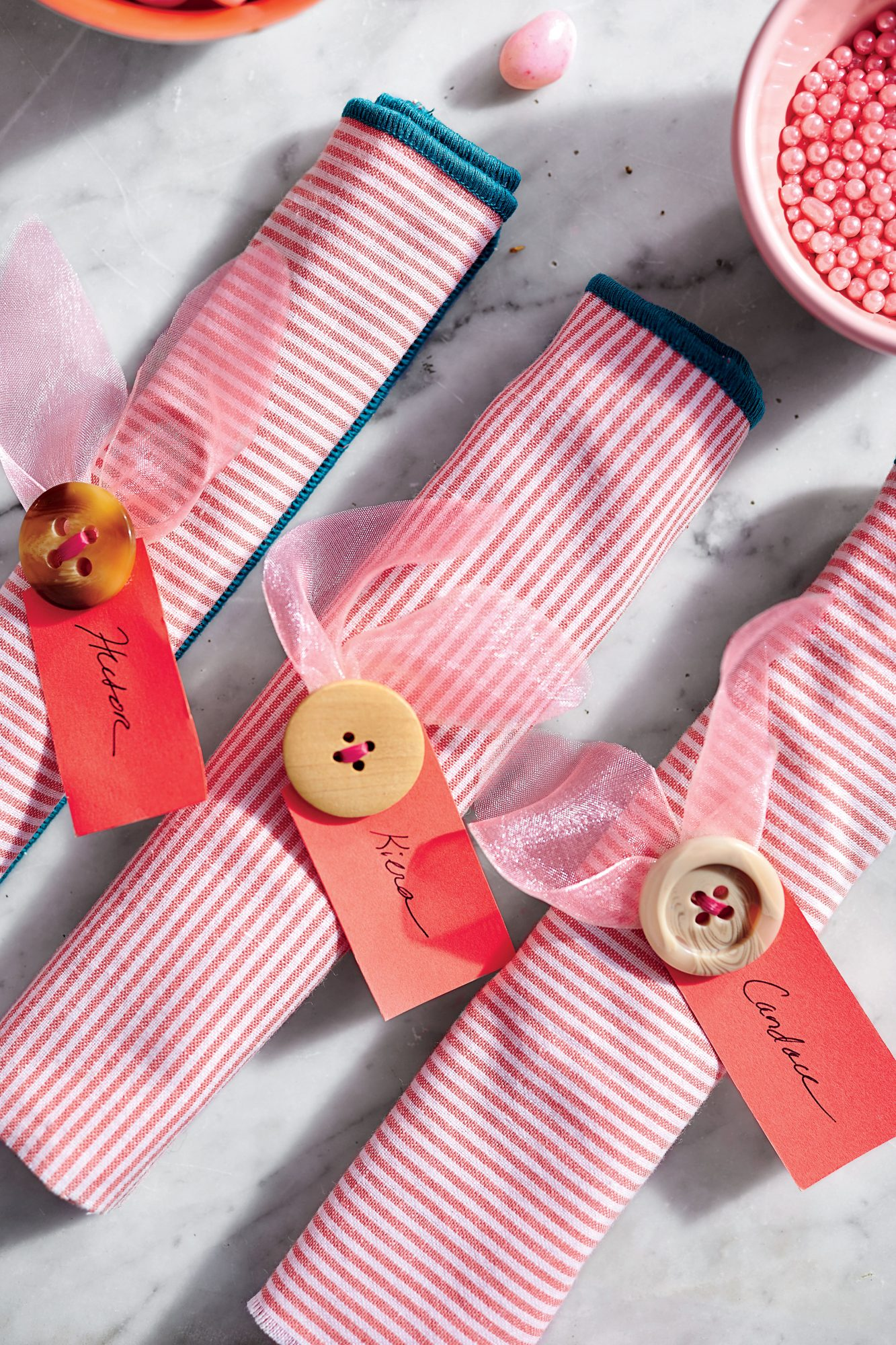 Button and Ribbon Napkin Rings with Pink Napkins