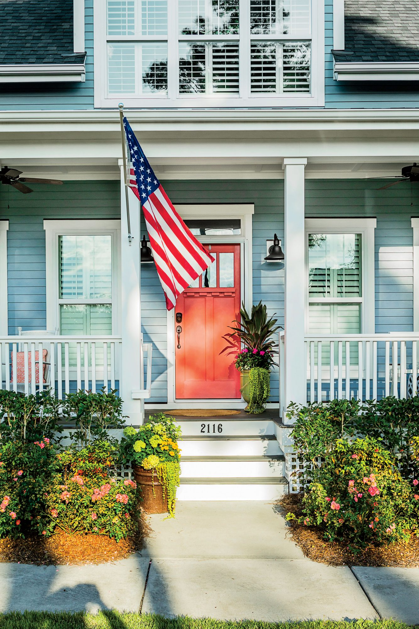 Blue Gray House with American Flag and Orange Front Door