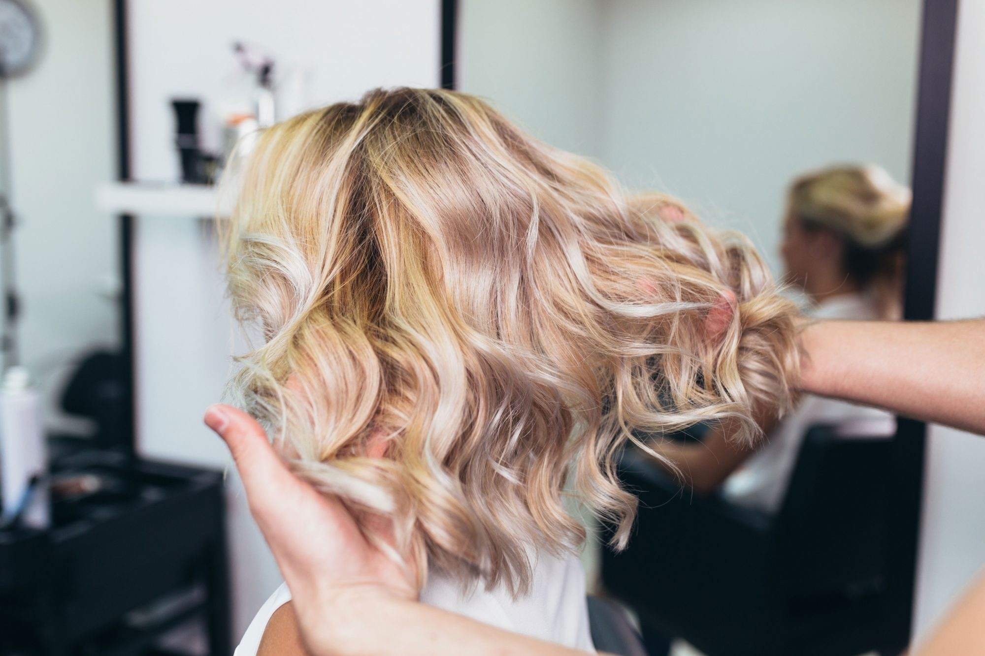 Woman With Blonde Highlights and Waves at The Salon