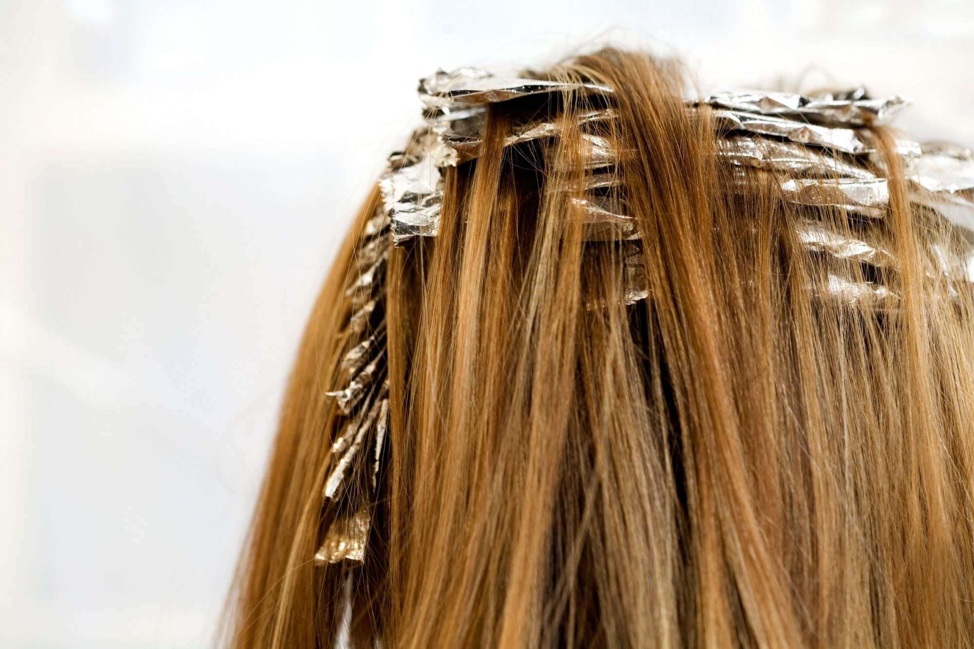 Woman With Highlight Foils In Her Hair