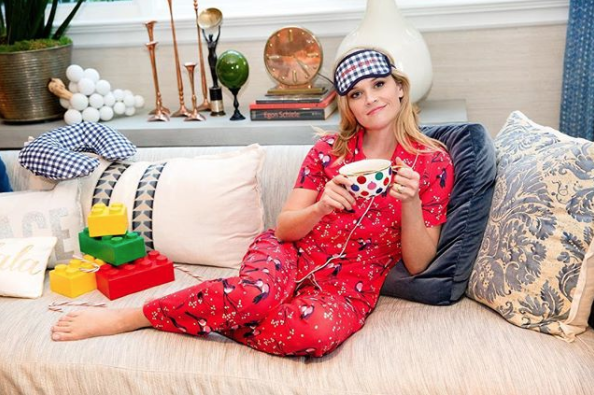 Reese Witherspoon in Pajamas on Couch
