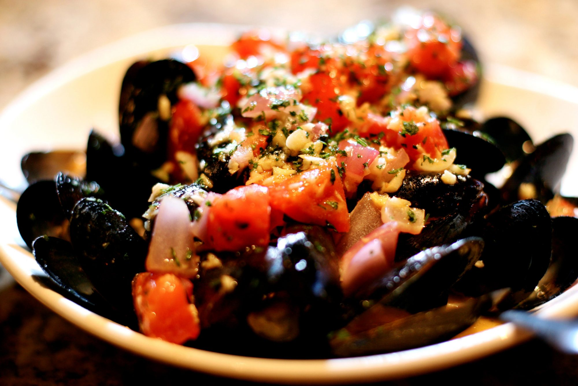 Mussels Josephine; tomatoes, garlic, basil - lemon wine sauce at Bonefish Grill in Boynton Beach.