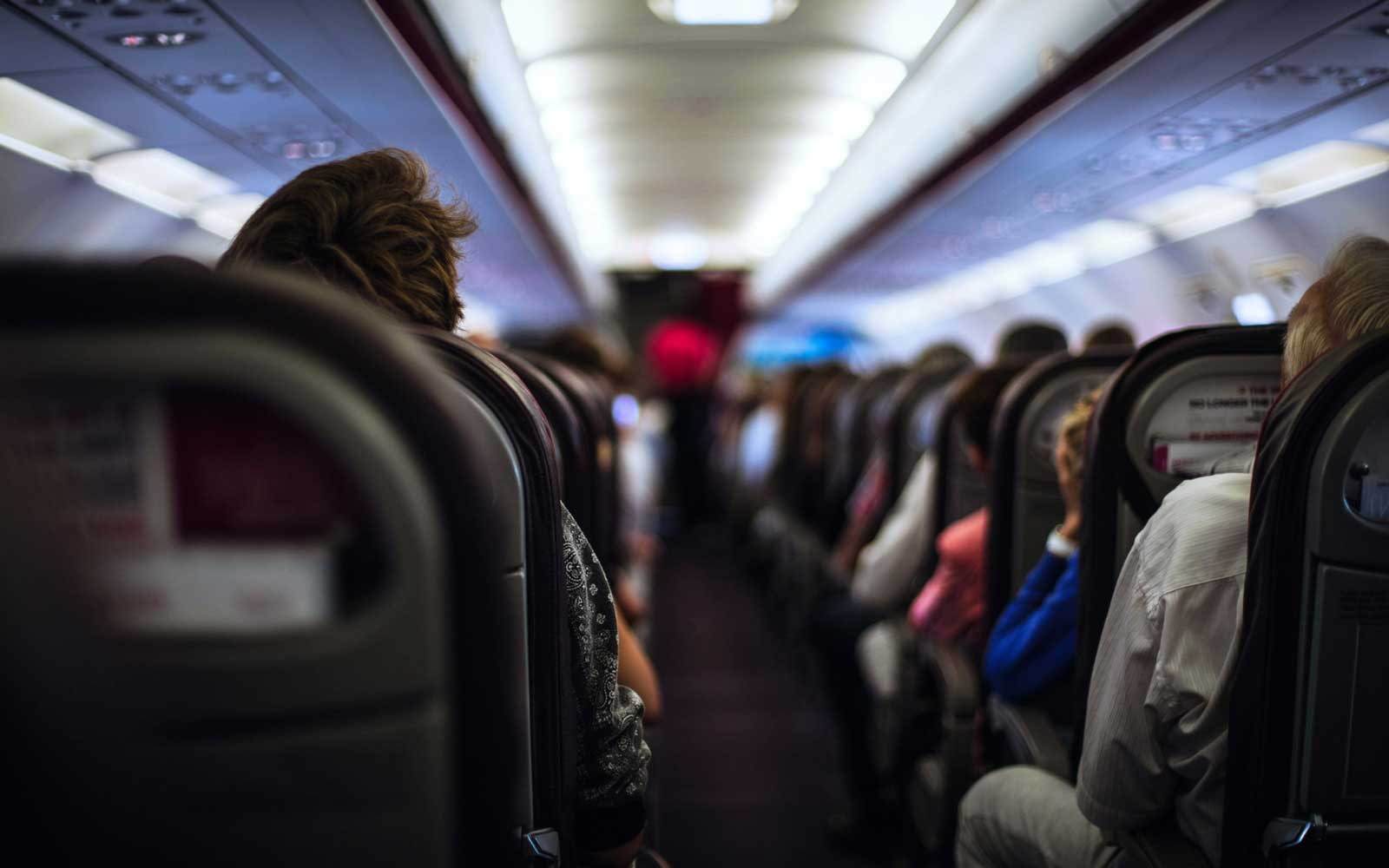 Interior Of An Airplane with Passengers