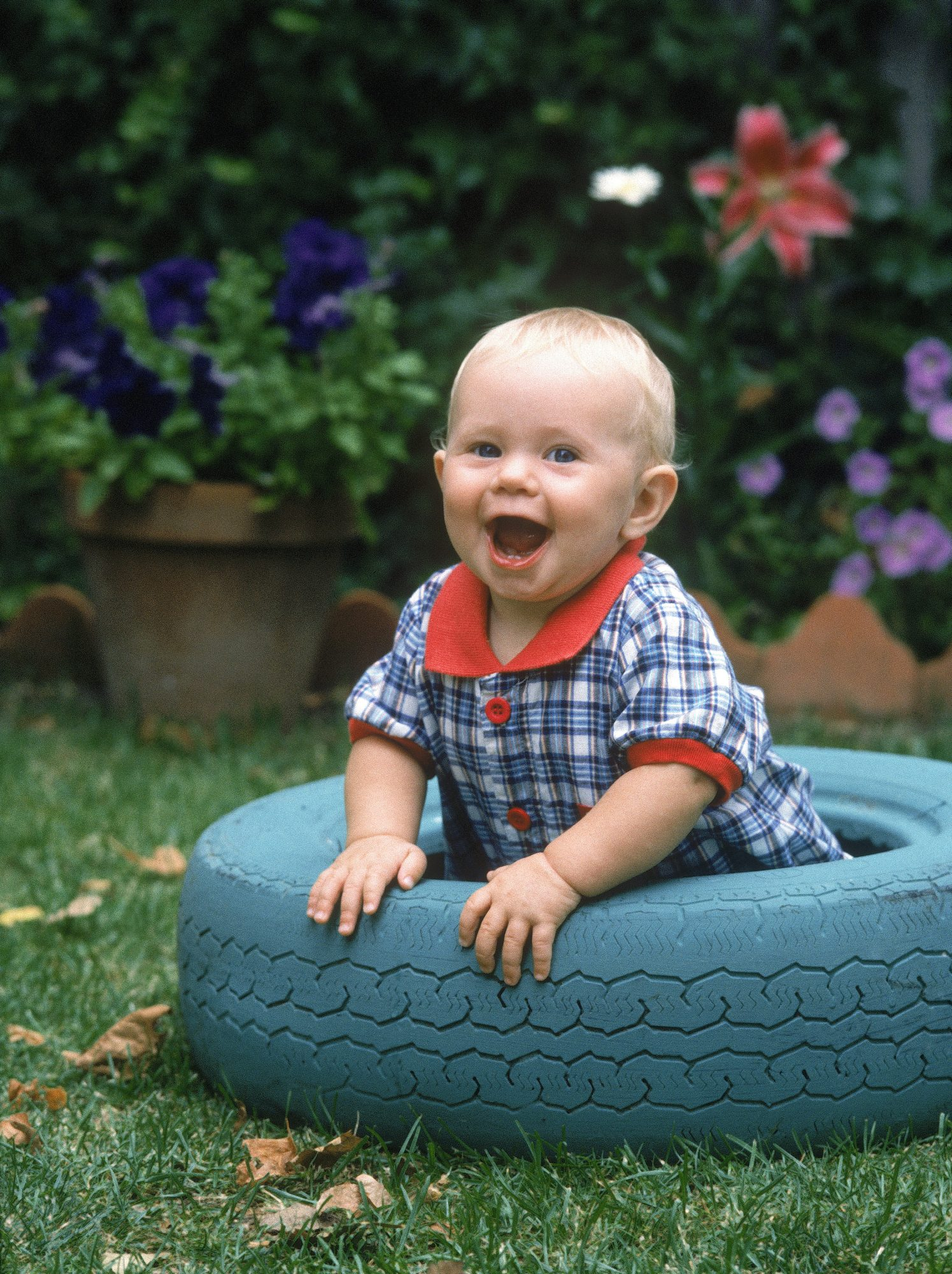 Toddler Laughing in a Tire