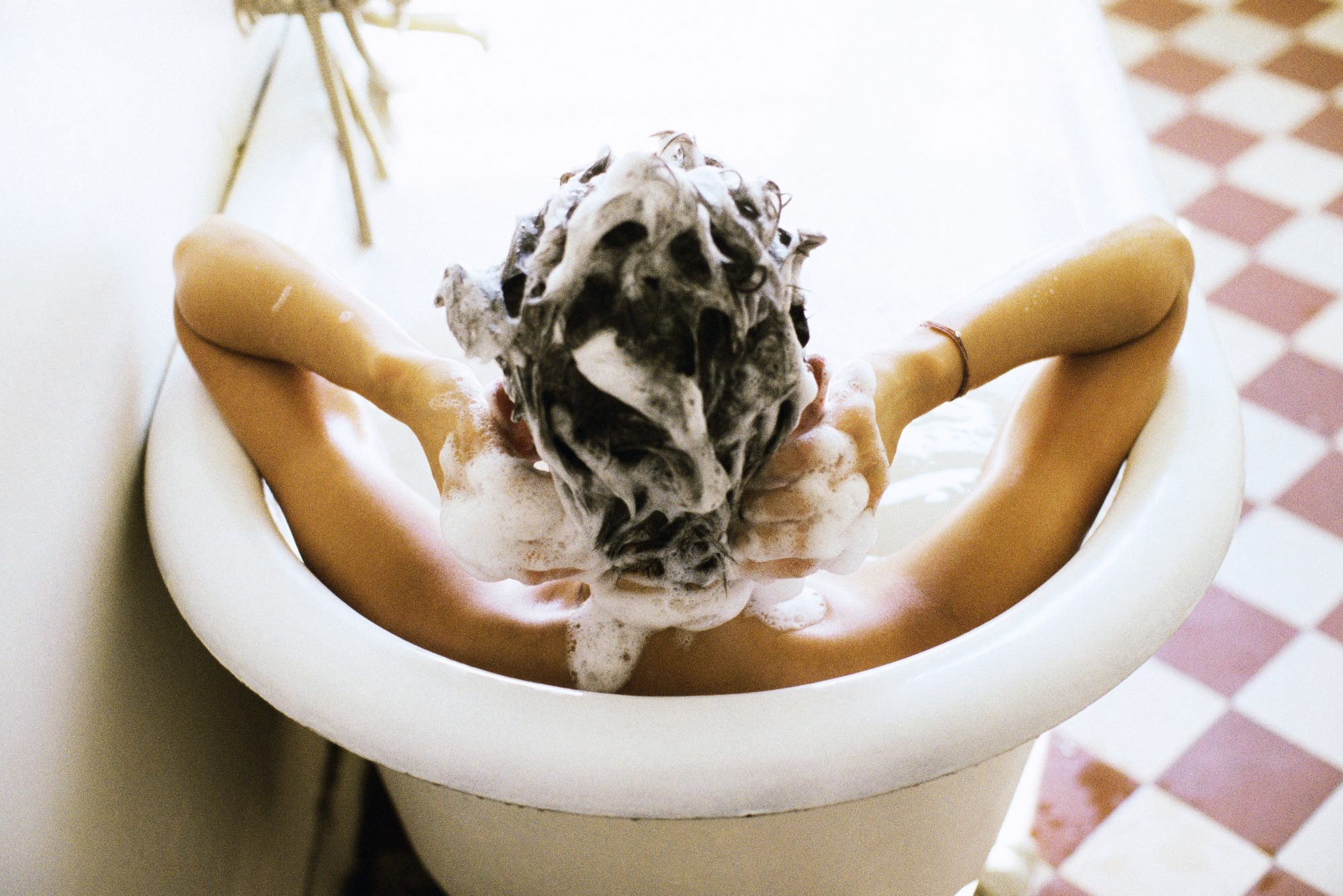 Woman In Tub Washing Her Hair