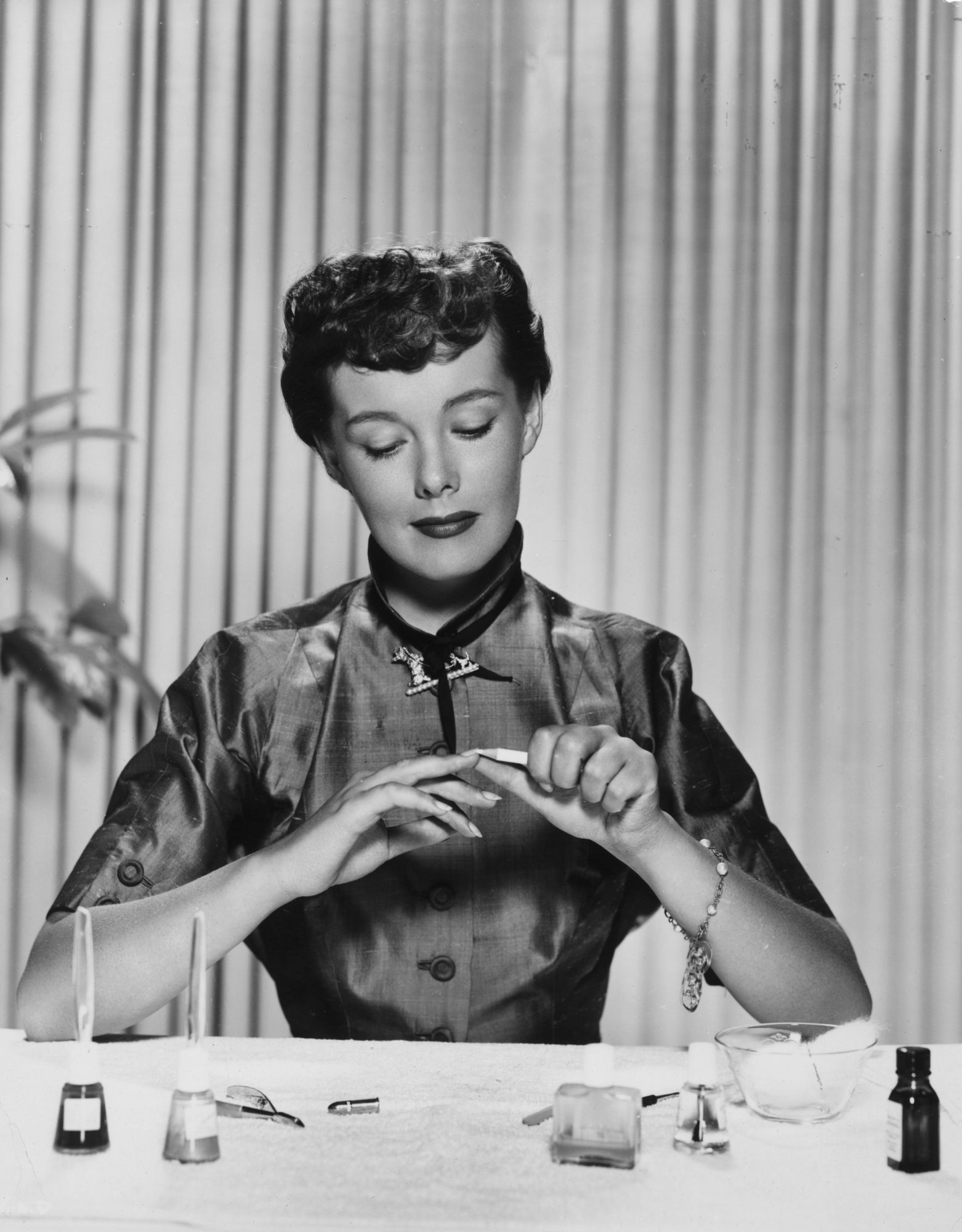 Woman Giving Herself Manicure