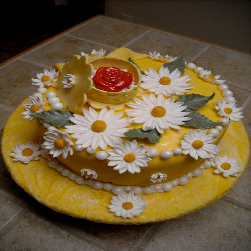 Flower Covered Derby Hat Cake