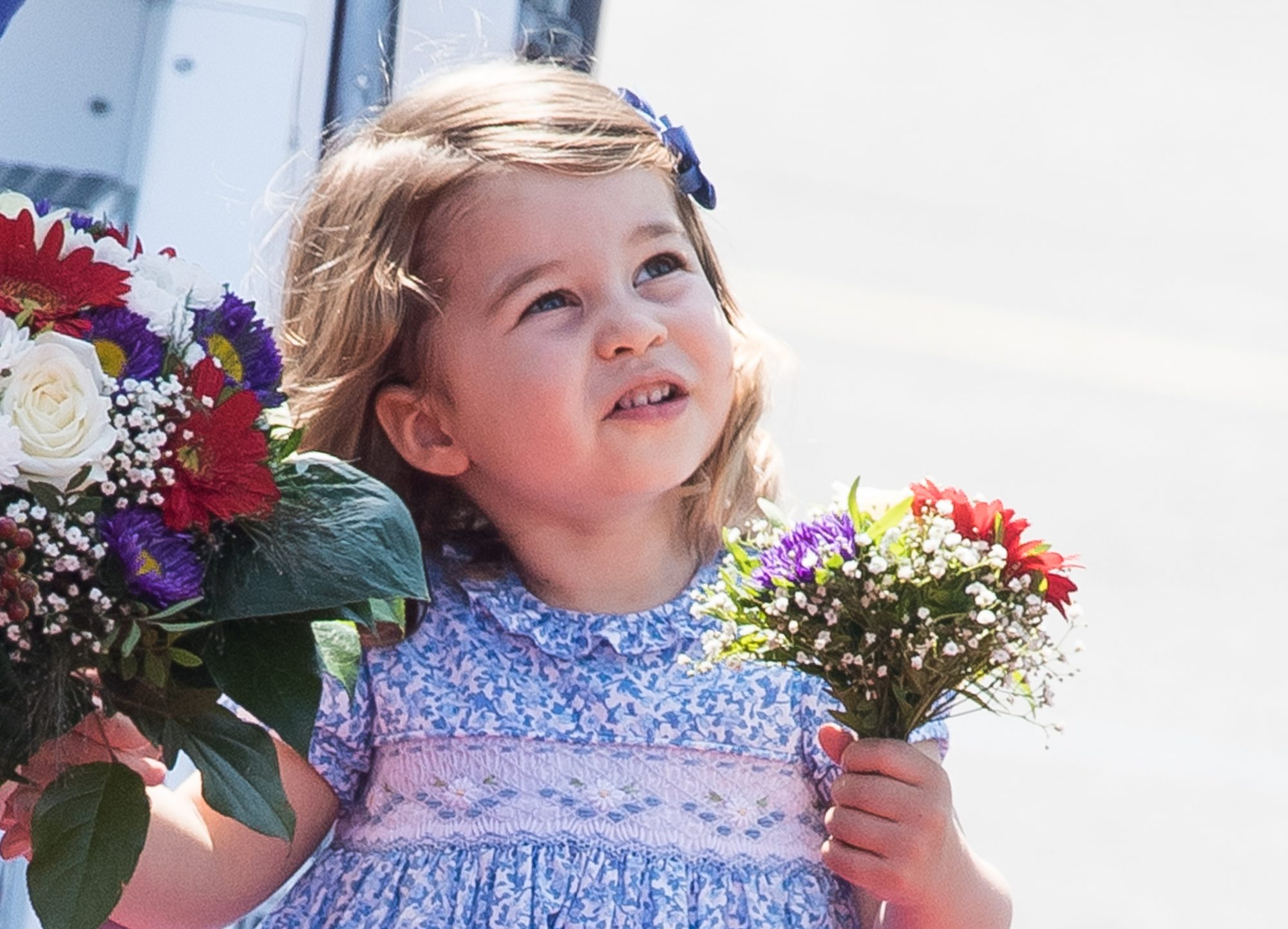 Princess Charlotte smiling with flowers
