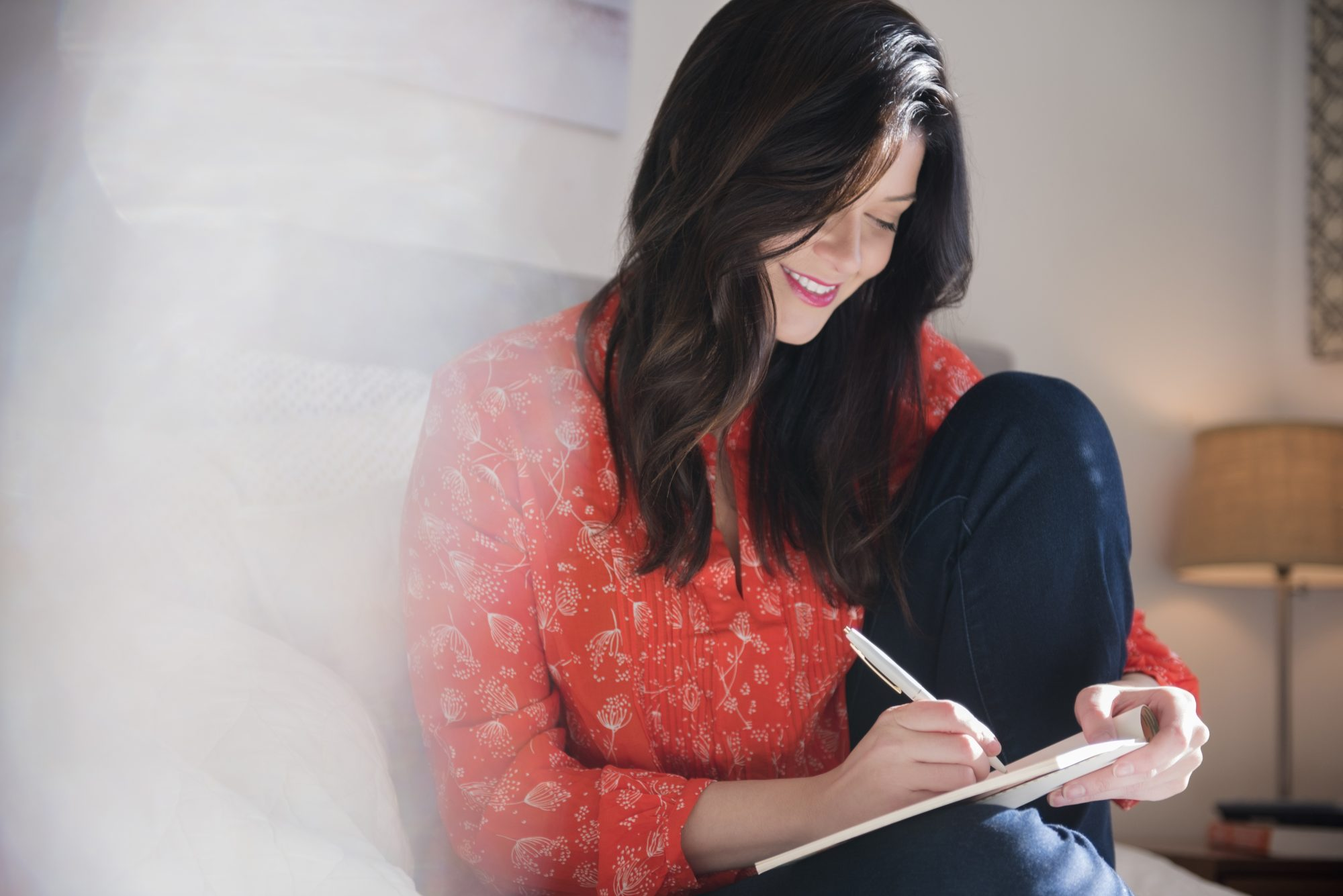 Woman with Notepad and Pen