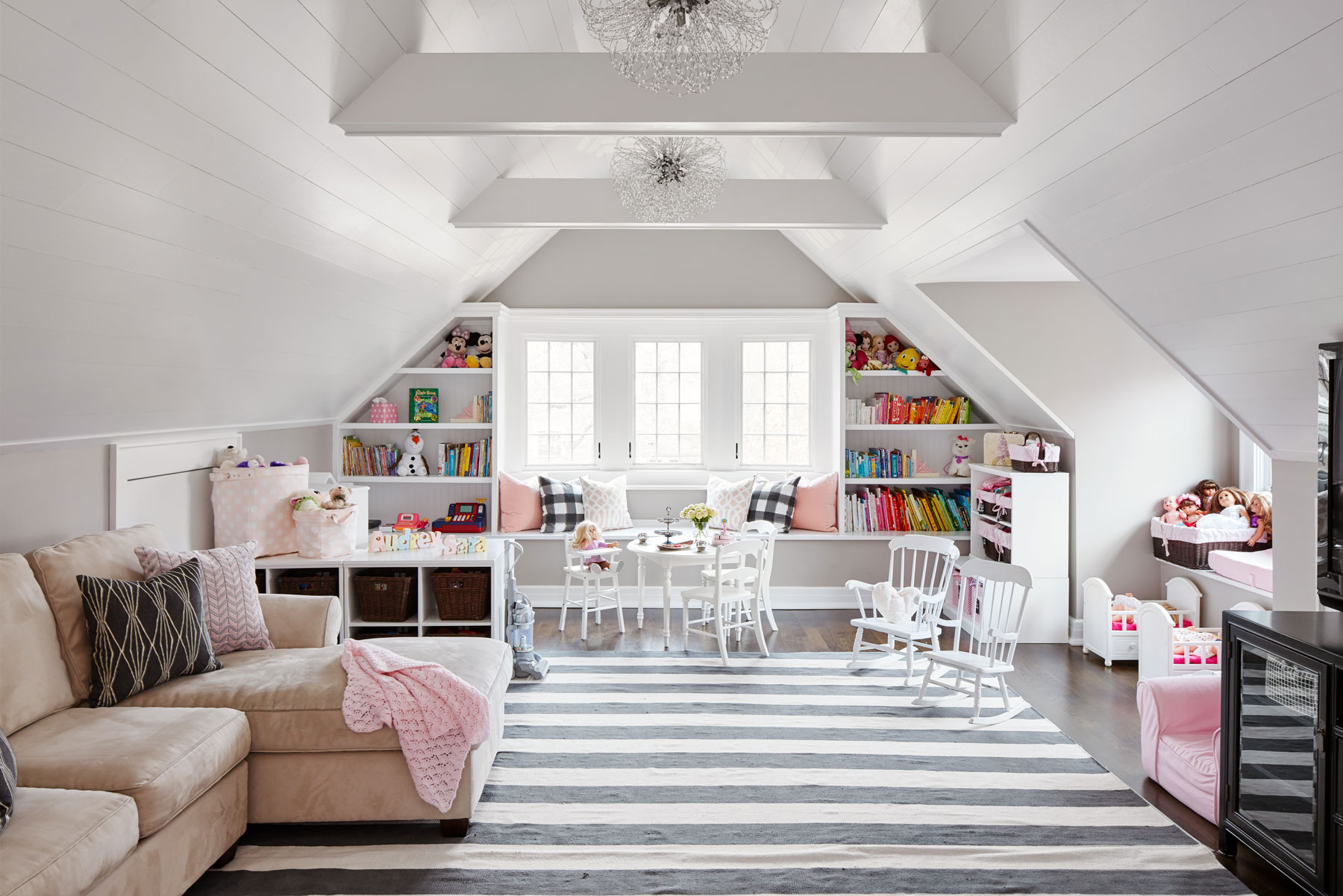 The playroom, for the family's three children, is tucked under the eaves at the top of the house, in what used to be the home's attic space.