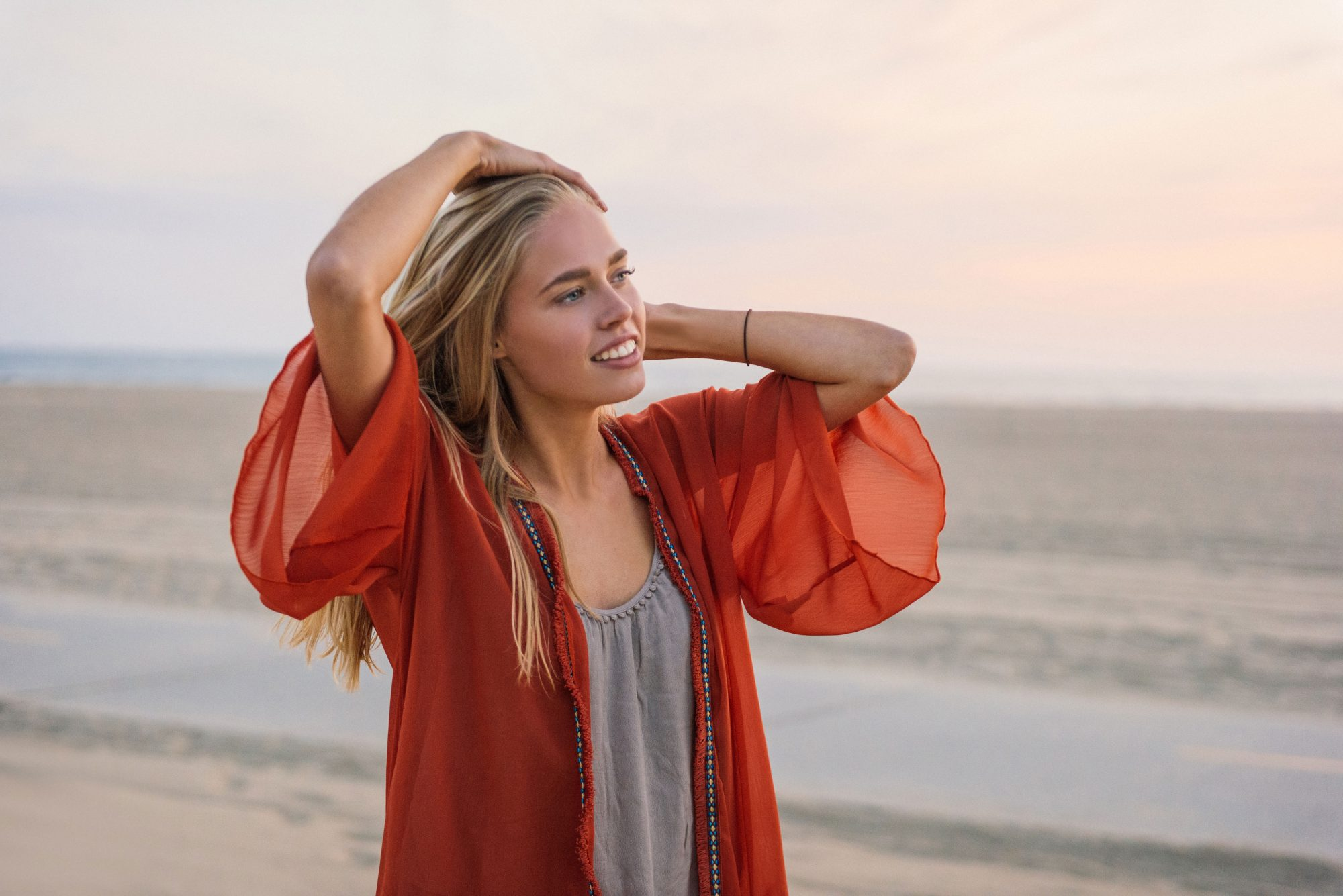 Woman on Beach with Long Blonde Hair