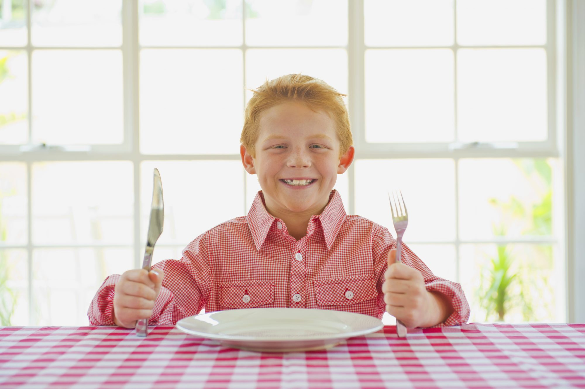 Boy Waiting for Dinner