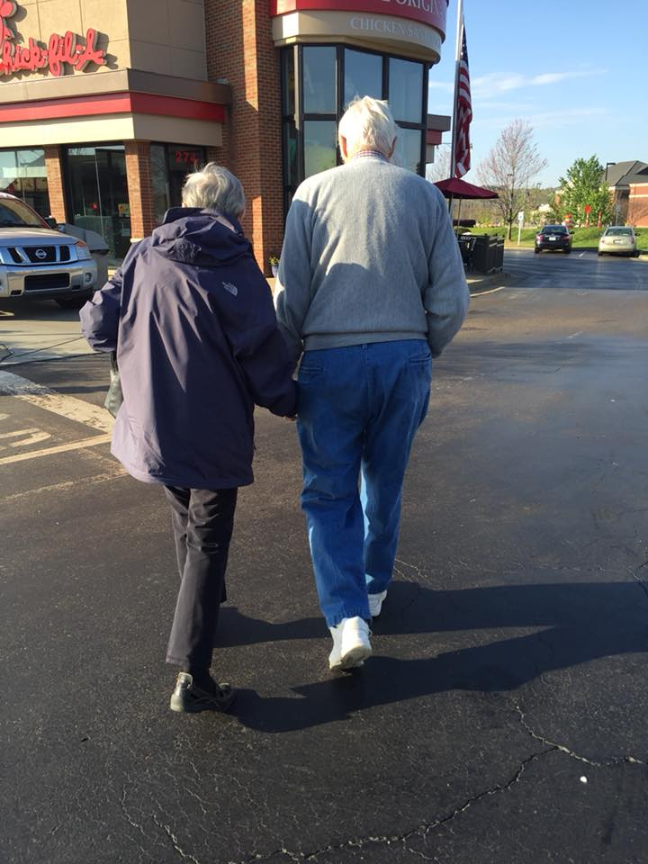 Mr. and Mrs. H.A. Lowry walking into their favorite Chick-fil-A in 2017