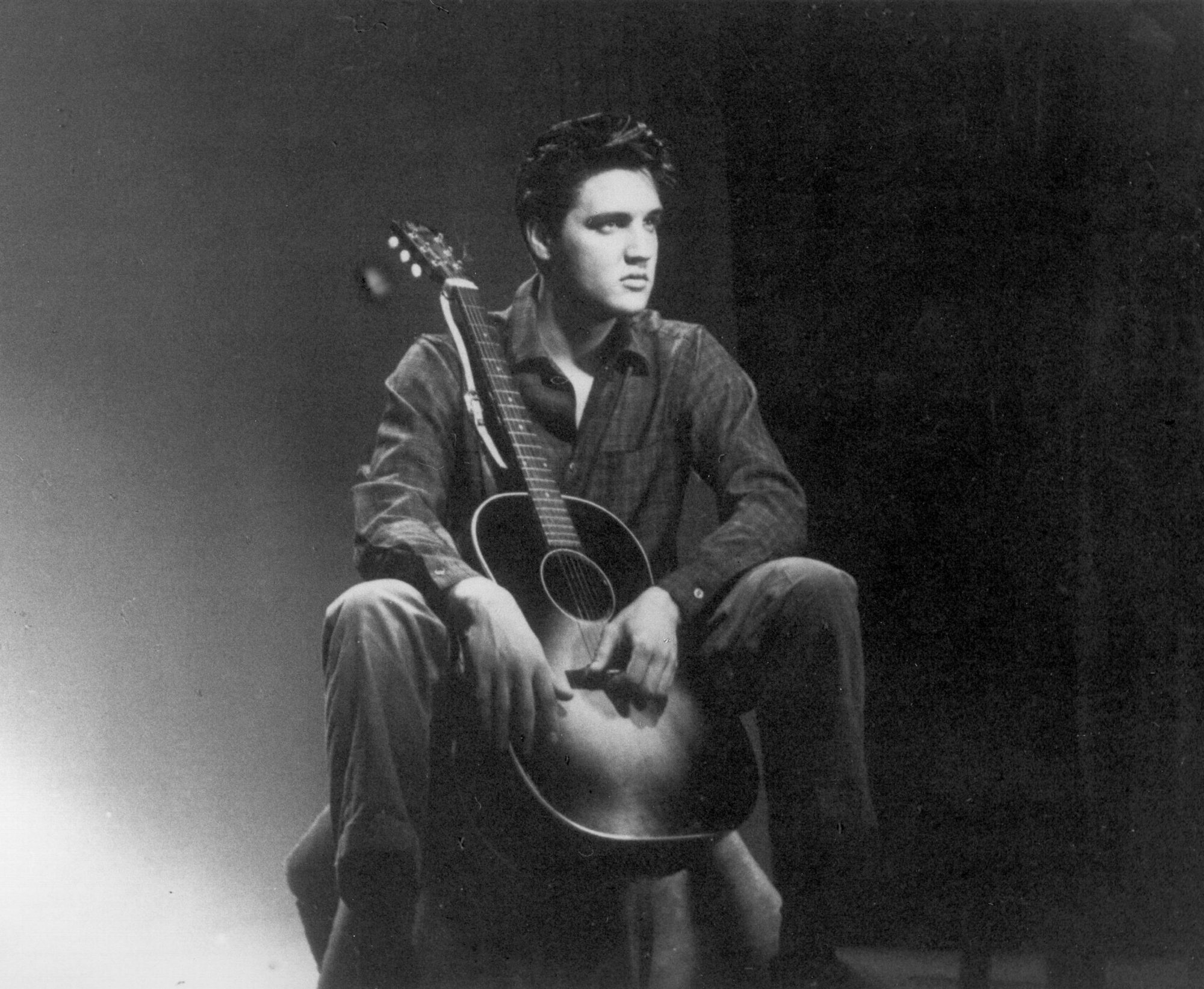 Elvis Seated with Guitar