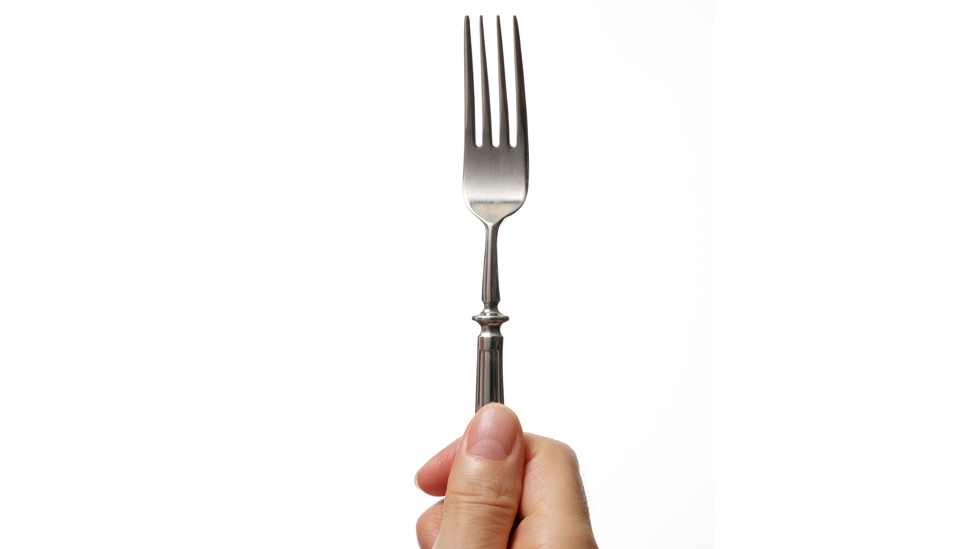 The Trick to Perfectly Hung Pictures? A Fork!