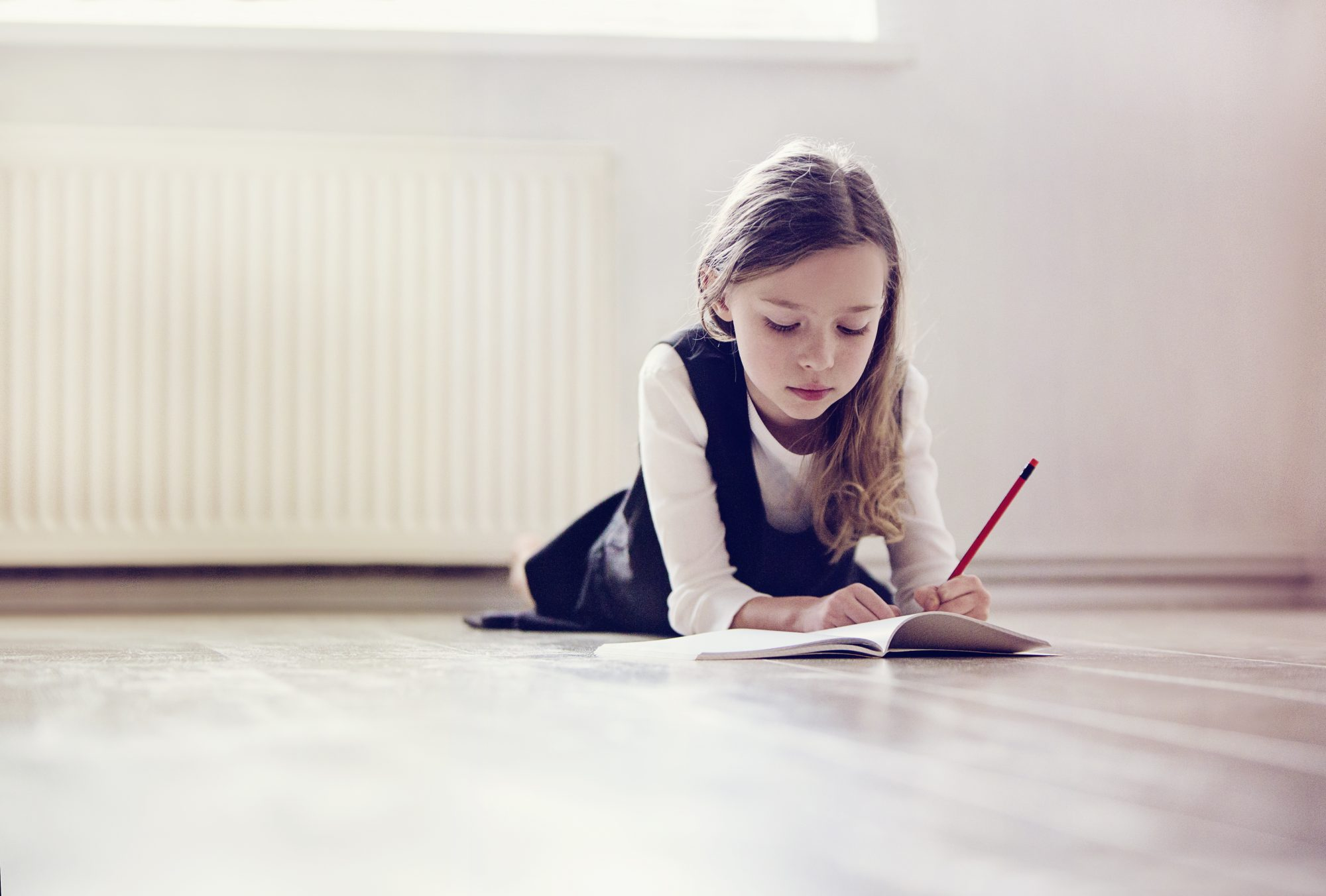 Little Girl Writing with Left Hand