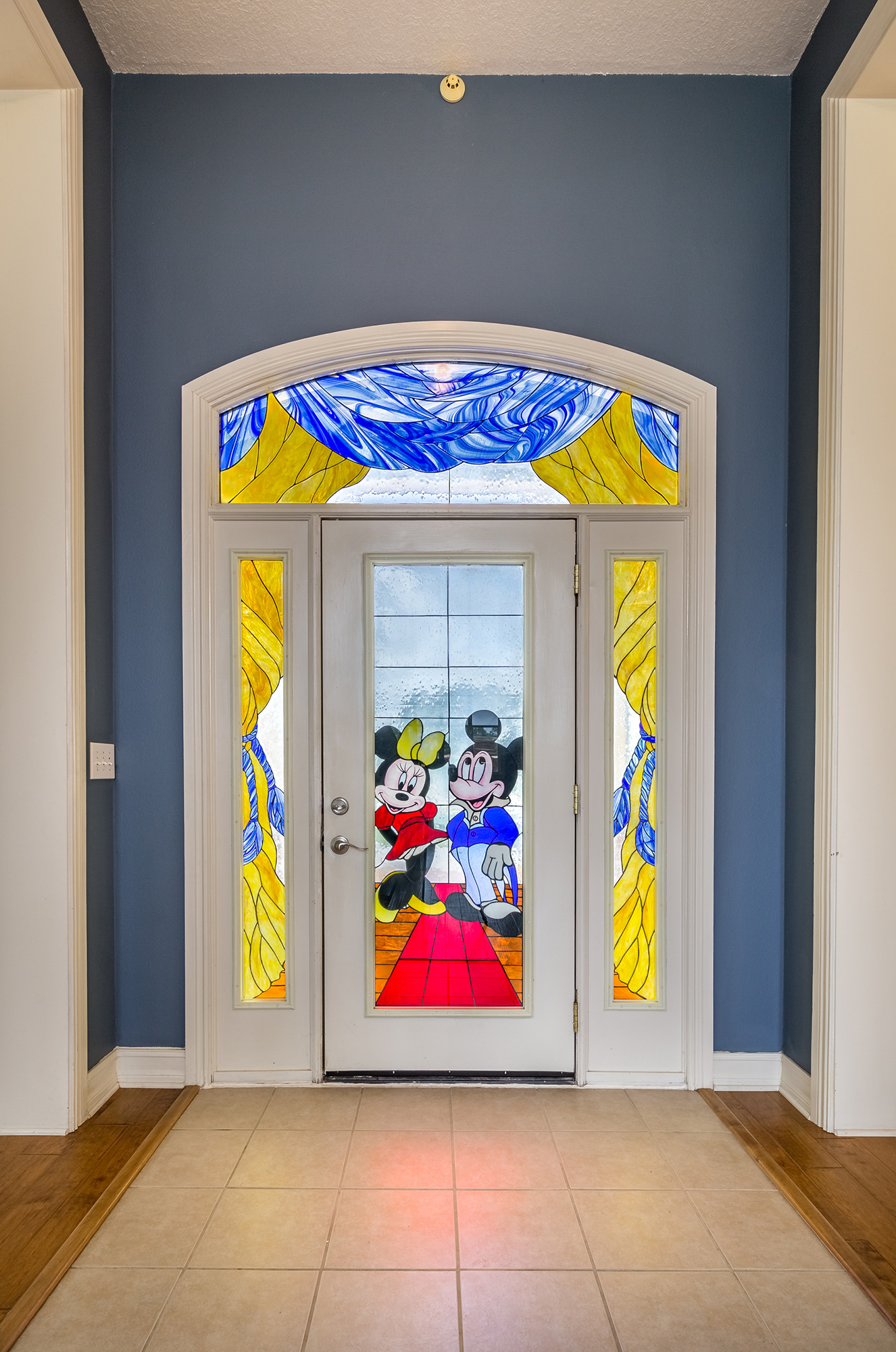 Disney Lovers' Florida House with Two Mickey Mouse–Shaped Pools Hits the Market for $850K disney-glass-stained-glass-door