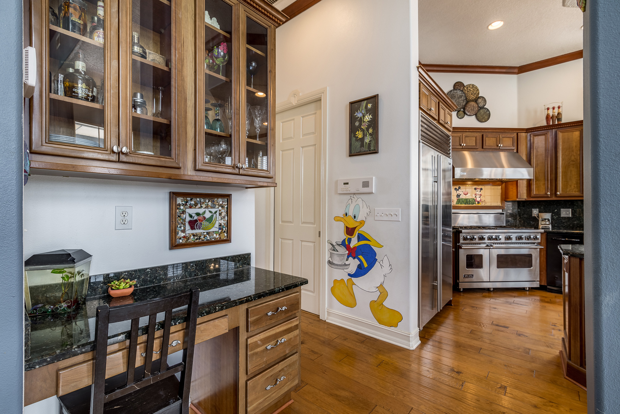 Disney Lovers' Florida House with Two Mickey Mouse–Shaped Pools Hits the Market for $850K disney-house-donald-duck-kitchen