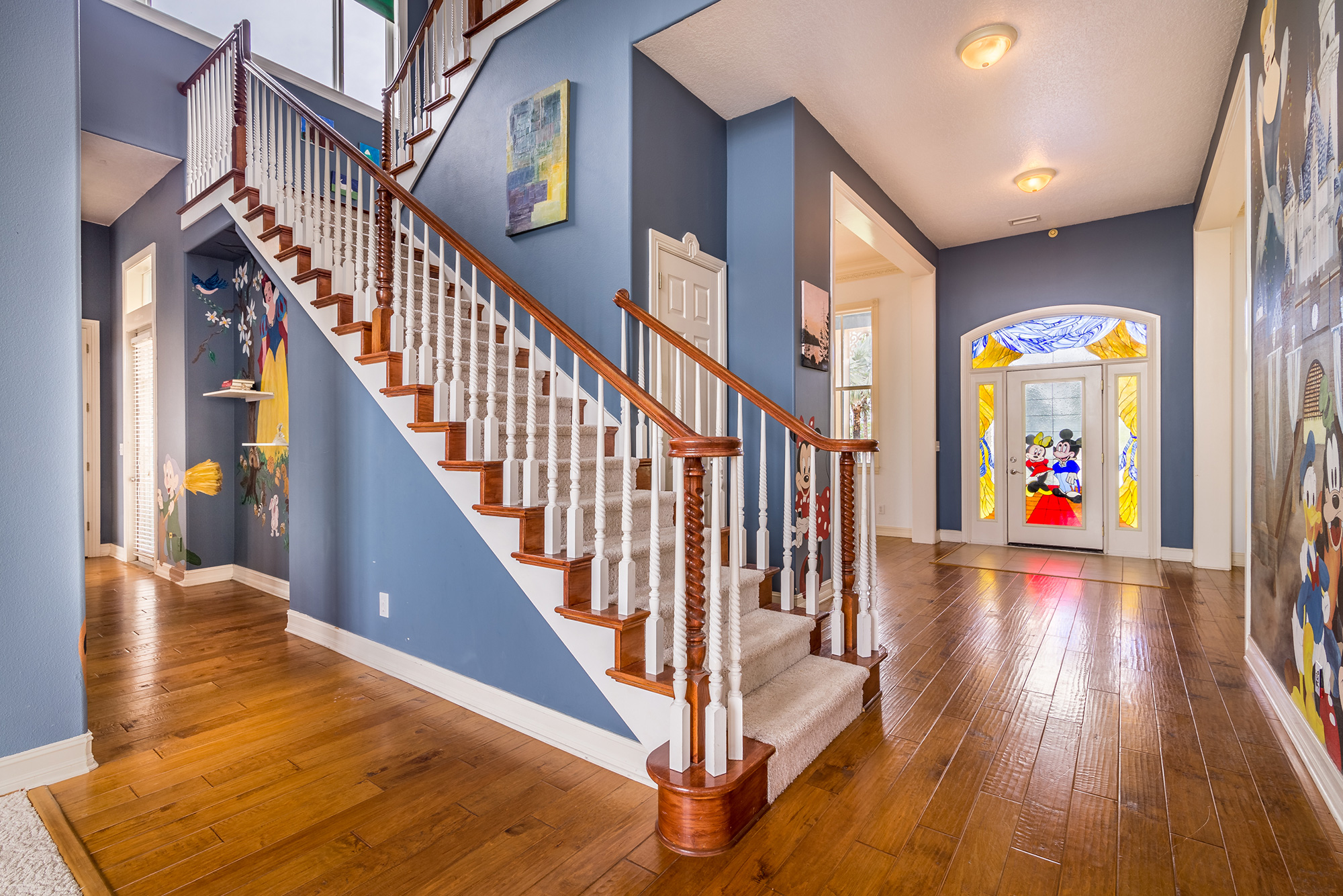 Disney Lovers' Florida House with Two Mickey Mouse–Shaped Pools Hits the Market for $850K disney-house-entryway