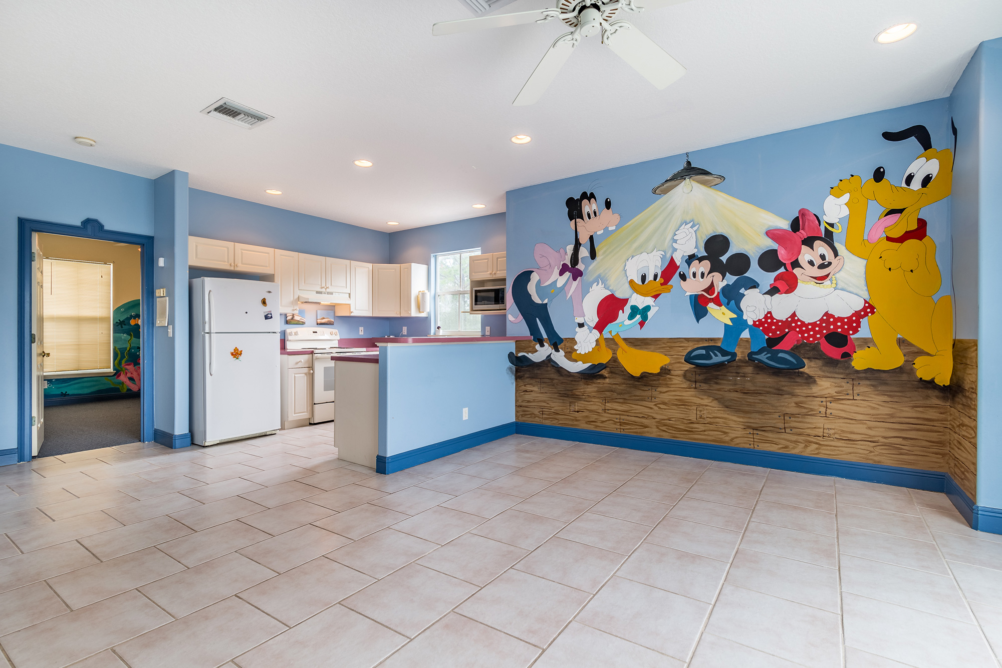 Disney Lovers' Florida House with Two Mickey Mouse–Shaped Pools Hits the Market for $850K disney-house-mural-character