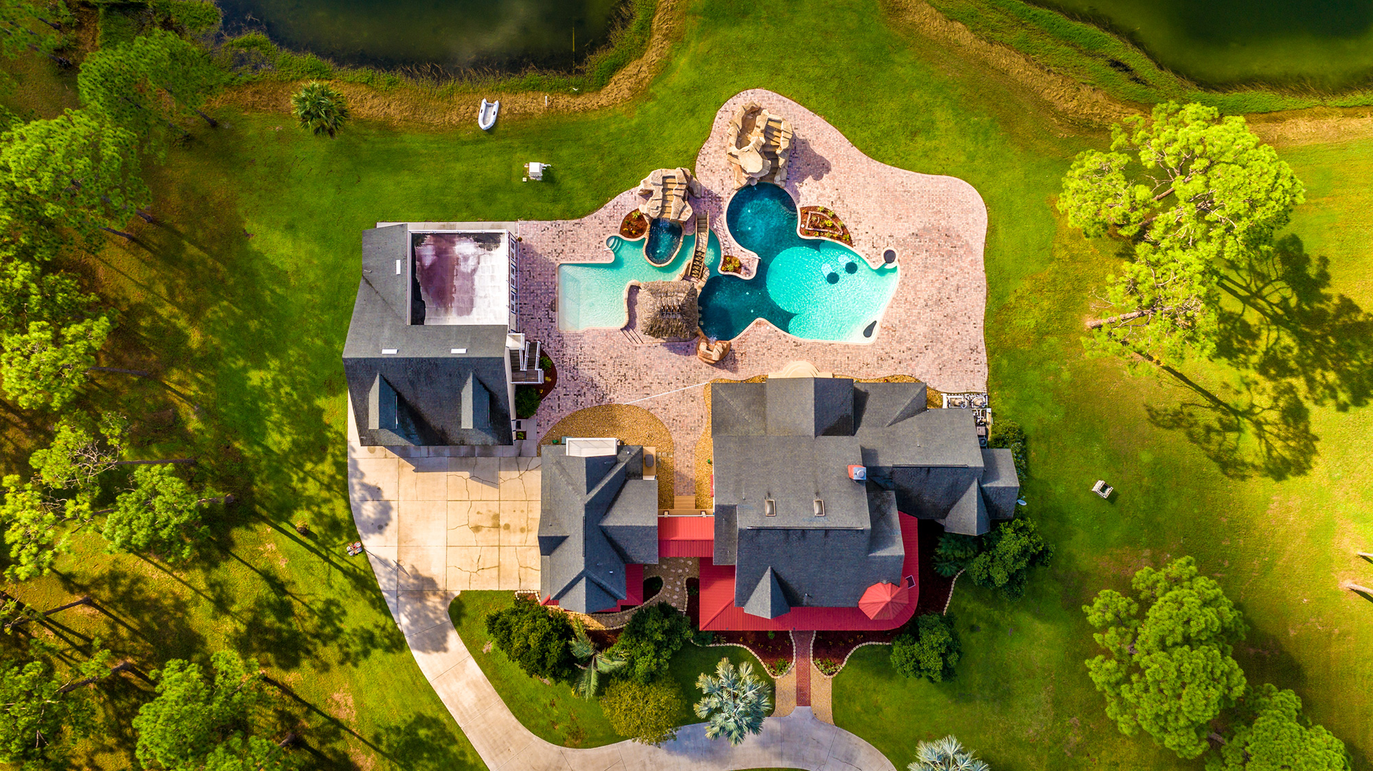 Disney Lovers' Florida House with Two Mickey Mouse–Shaped Pools Hits the Market for $850K disney-house-overview-backyard
