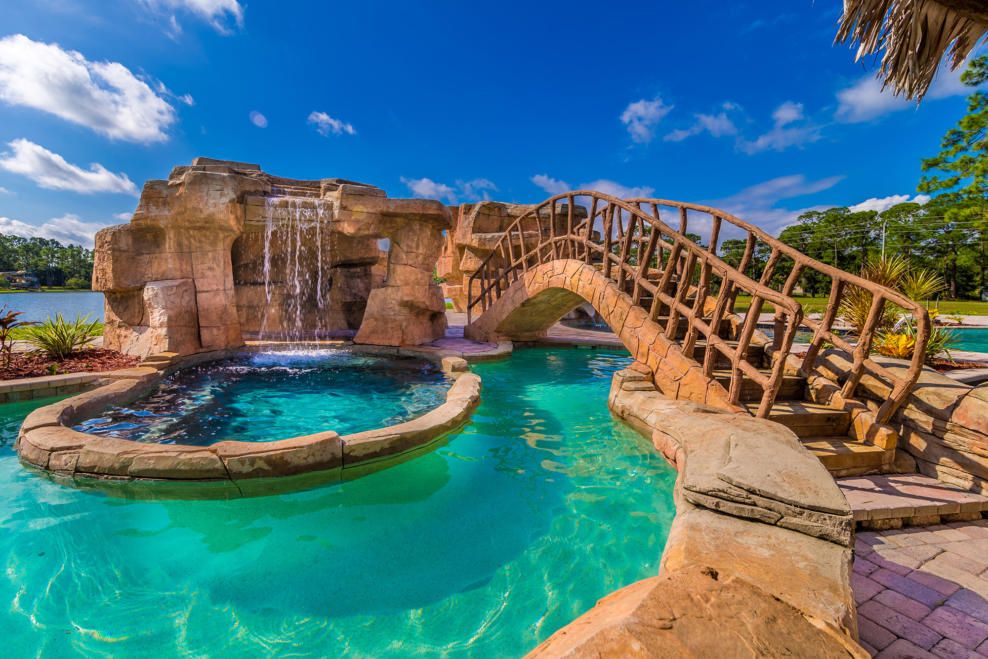 Disney Lovers' Florida House with Two Mickey Mouse–Shaped Pools Hits the Market for $850K disney-house-pool-bridge