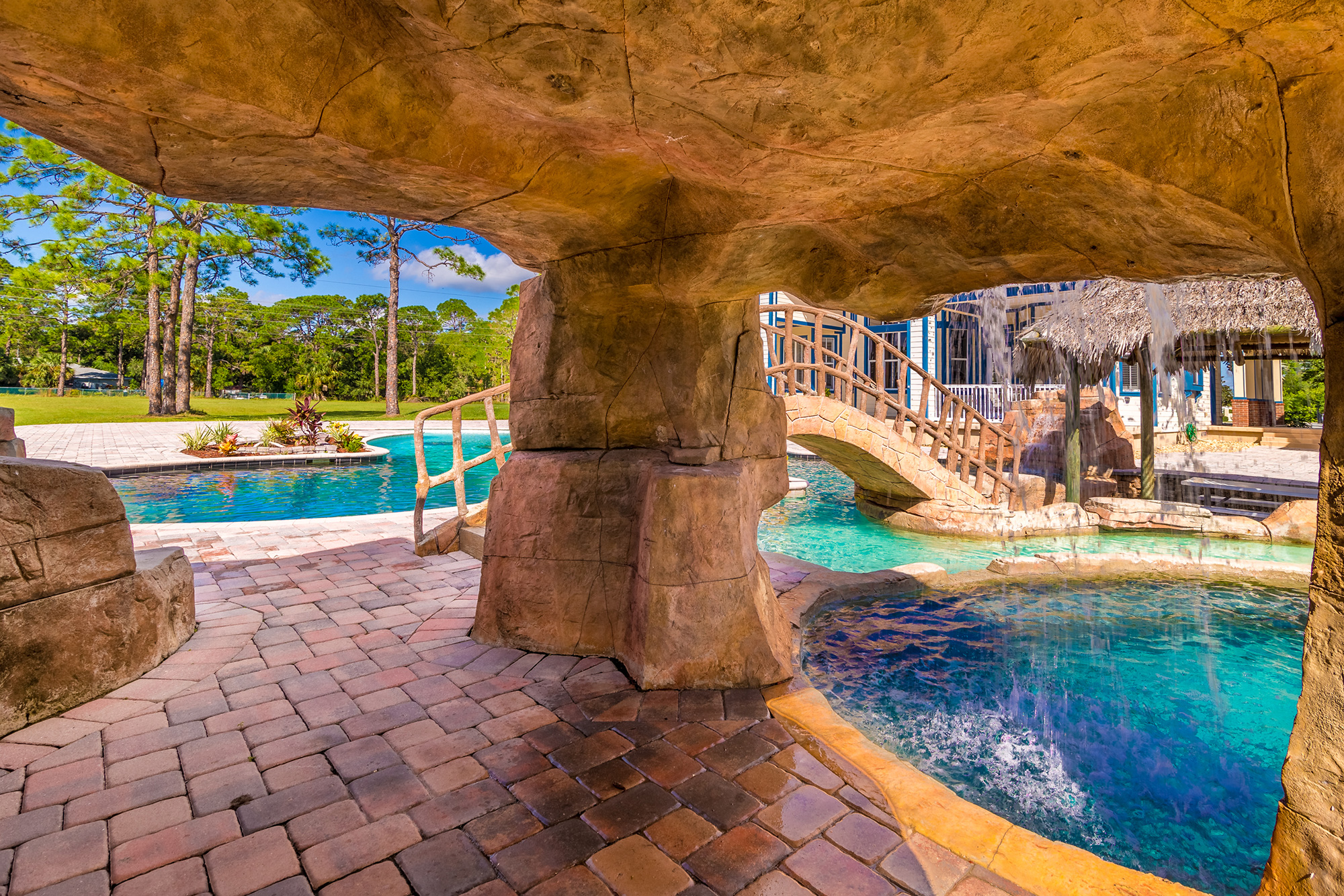 Disney Lovers' Florida House with Two Mickey Mouse–Shaped Pools Hits the Market for $850K disney-house-pool-cave
