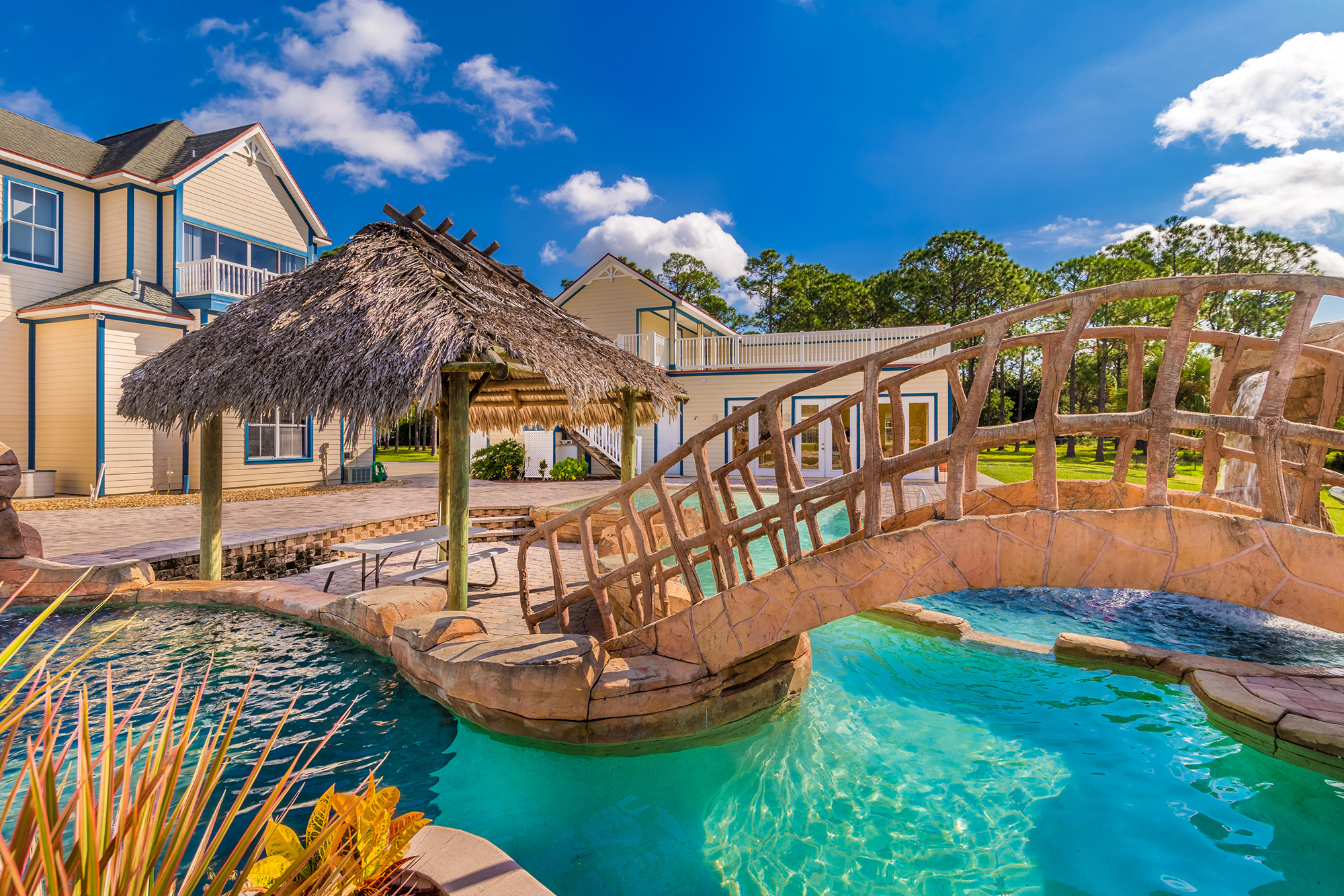 Disney Lovers' Florida House with Two Mickey Mouse–Shaped Pools Hits the Market for $850K disney-house-pool-tiki-hut
