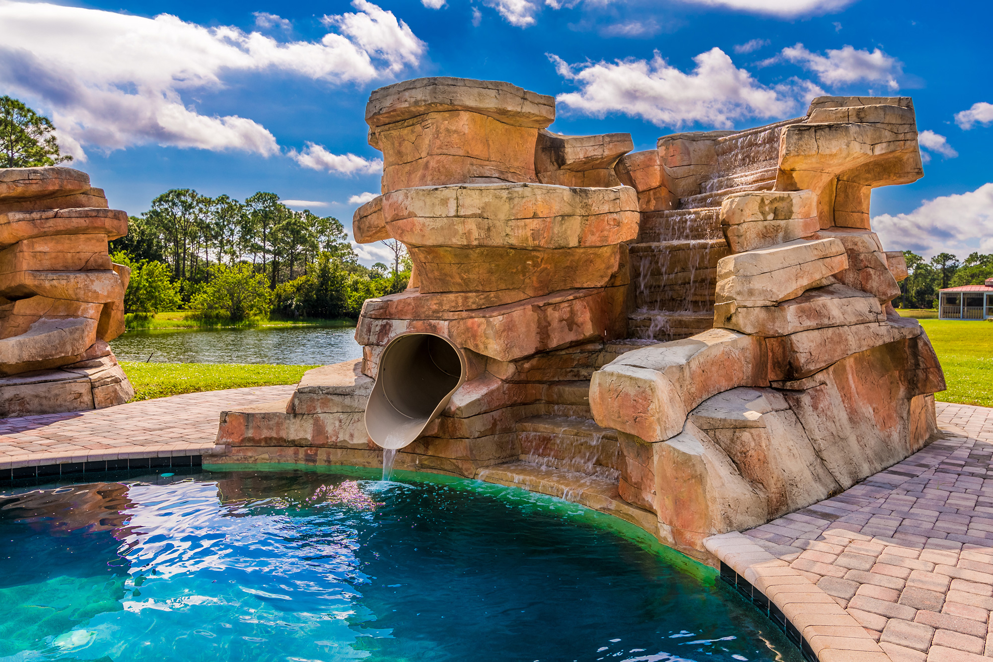 Disney Lovers' Florida House with Two Mickey Mouse–Shaped Pools Hits the Market for $850K disney-house-pool-waterfall