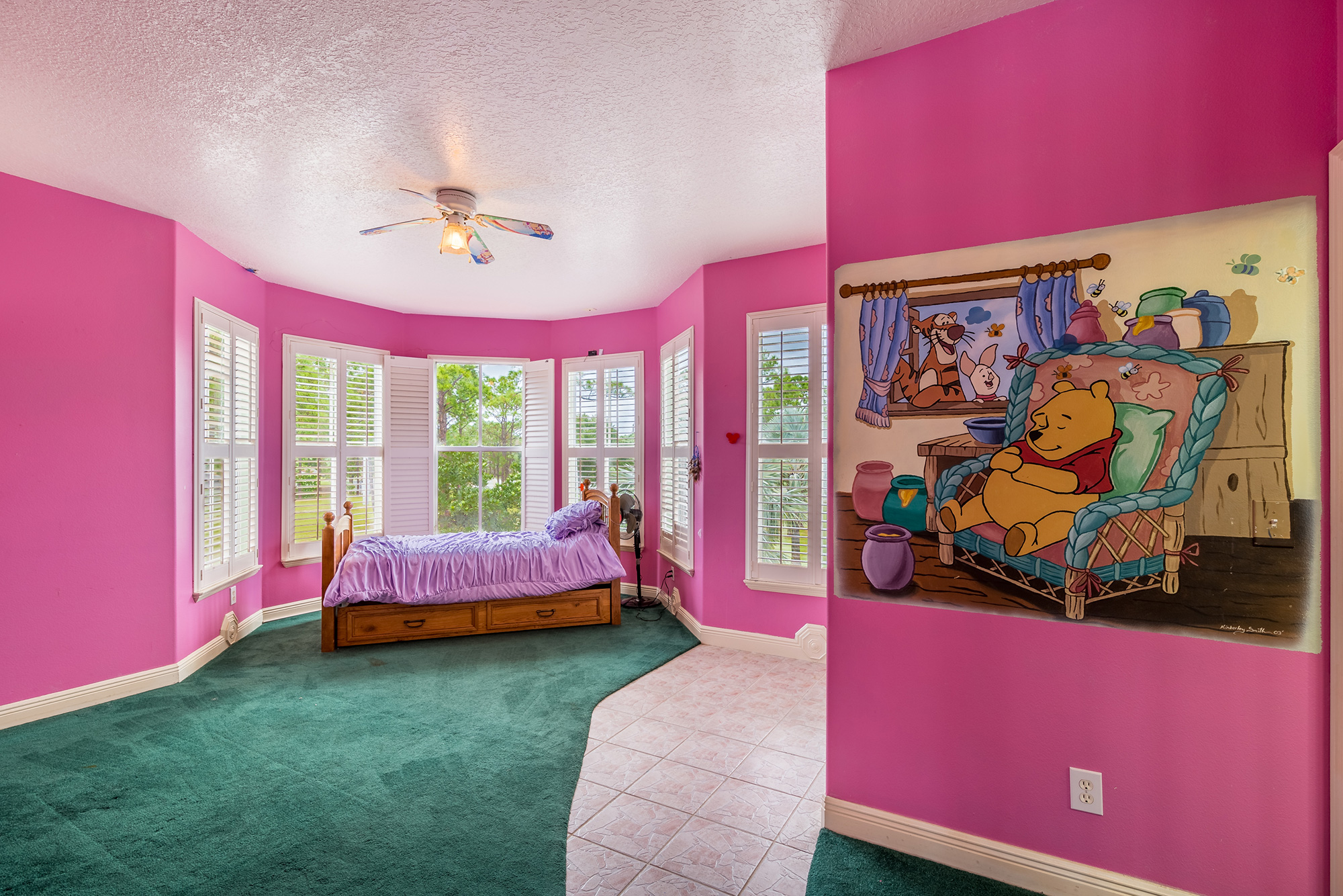 Disney Lovers' Florida House with Two Mickey Mouse–Shaped Pools Hits the Market for $850K disney-house-winnie-the-pooh