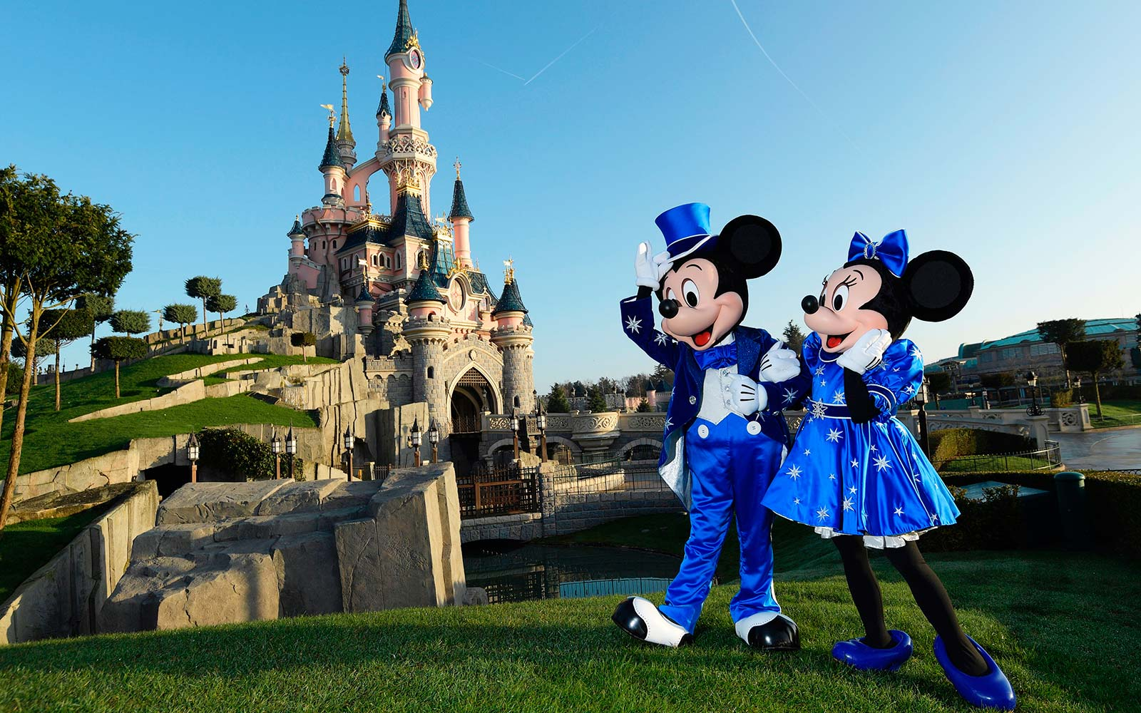 People Keep Scattering Ashes at Disney Theme Parks — and Custodians Are Over It disneyland-mickey-minnie-mouse-disneypoint11171