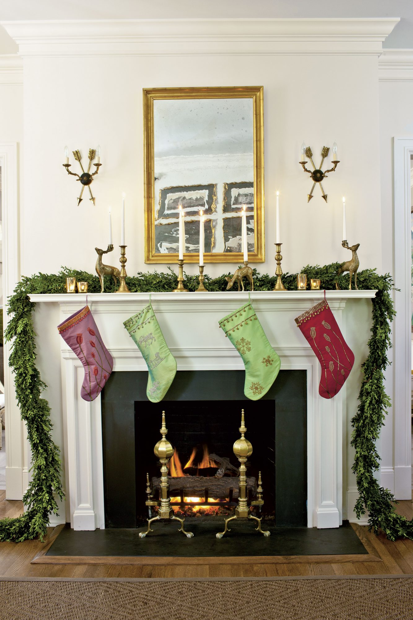 Sarah Tuttle Boxwood Garland on the Mantel for Christmas with Stockings