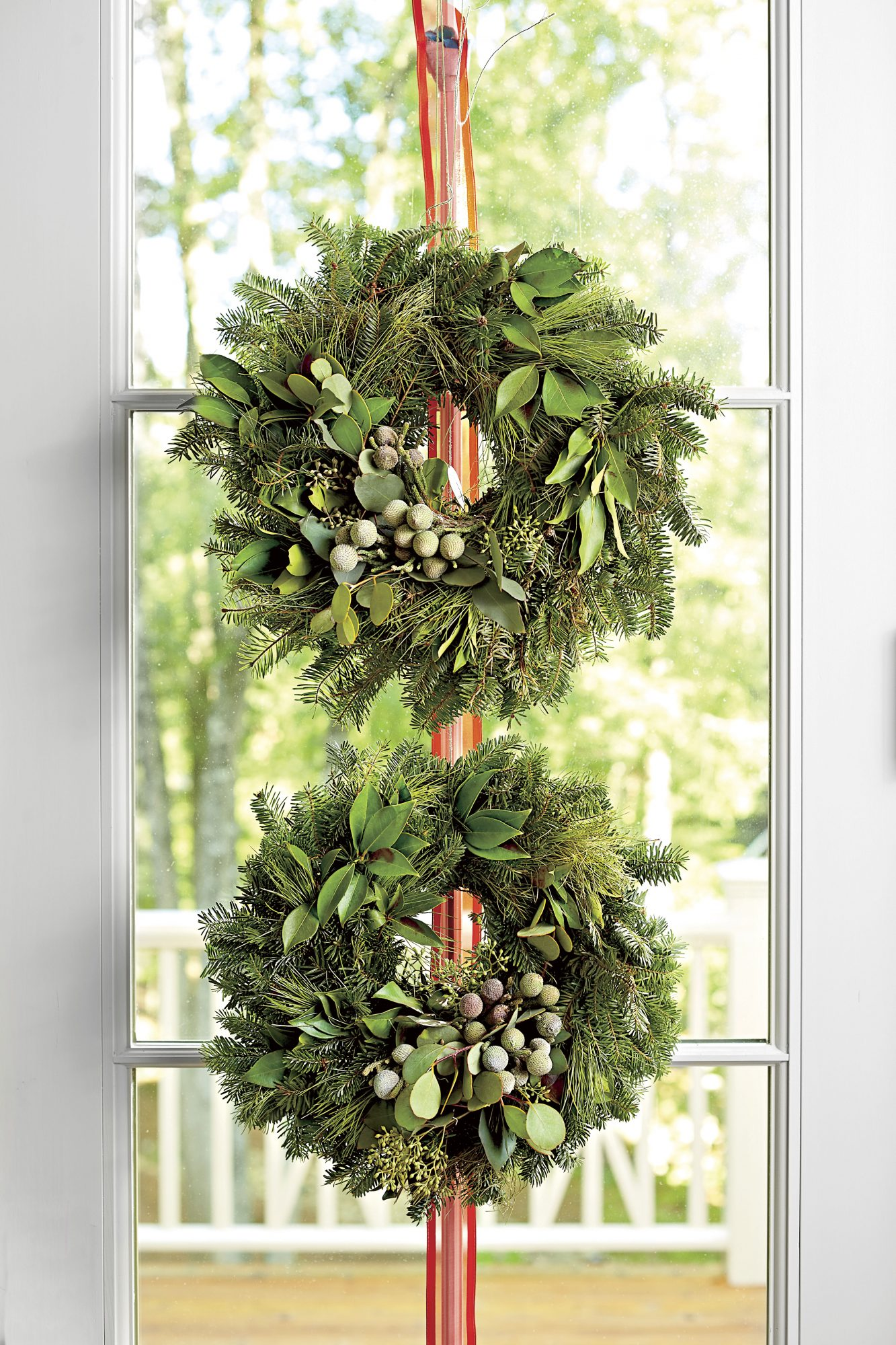 Two Wreaths Hanging on Door
