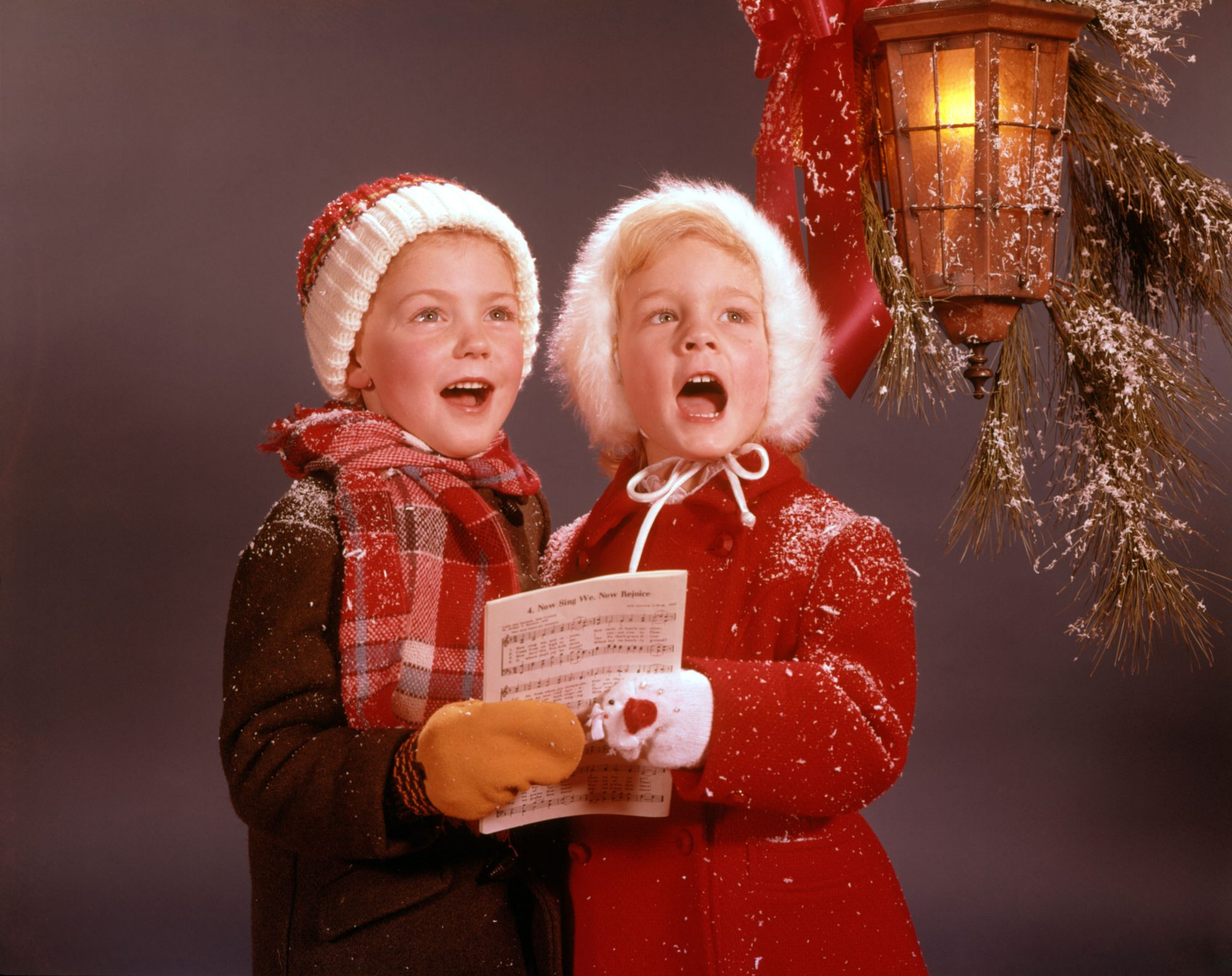 Two Children Singing Christmas Carols