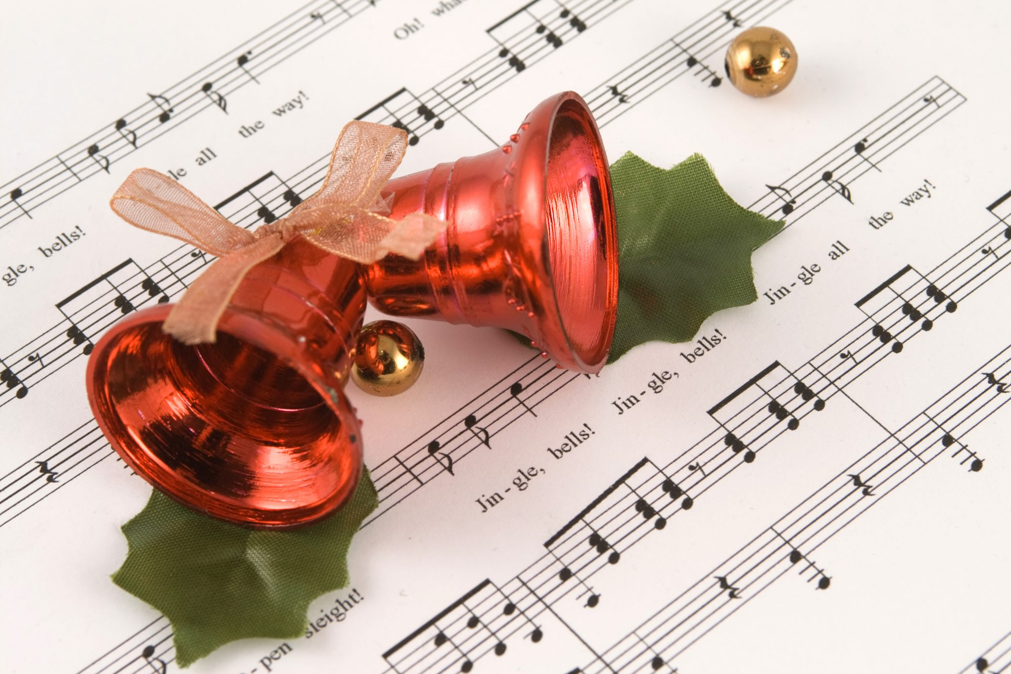 Red Jingle Bells over Sheet Music