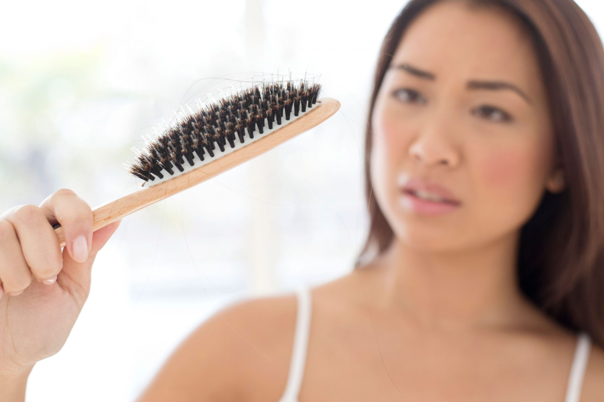 Woman Holding Hair Brush Thin Hair