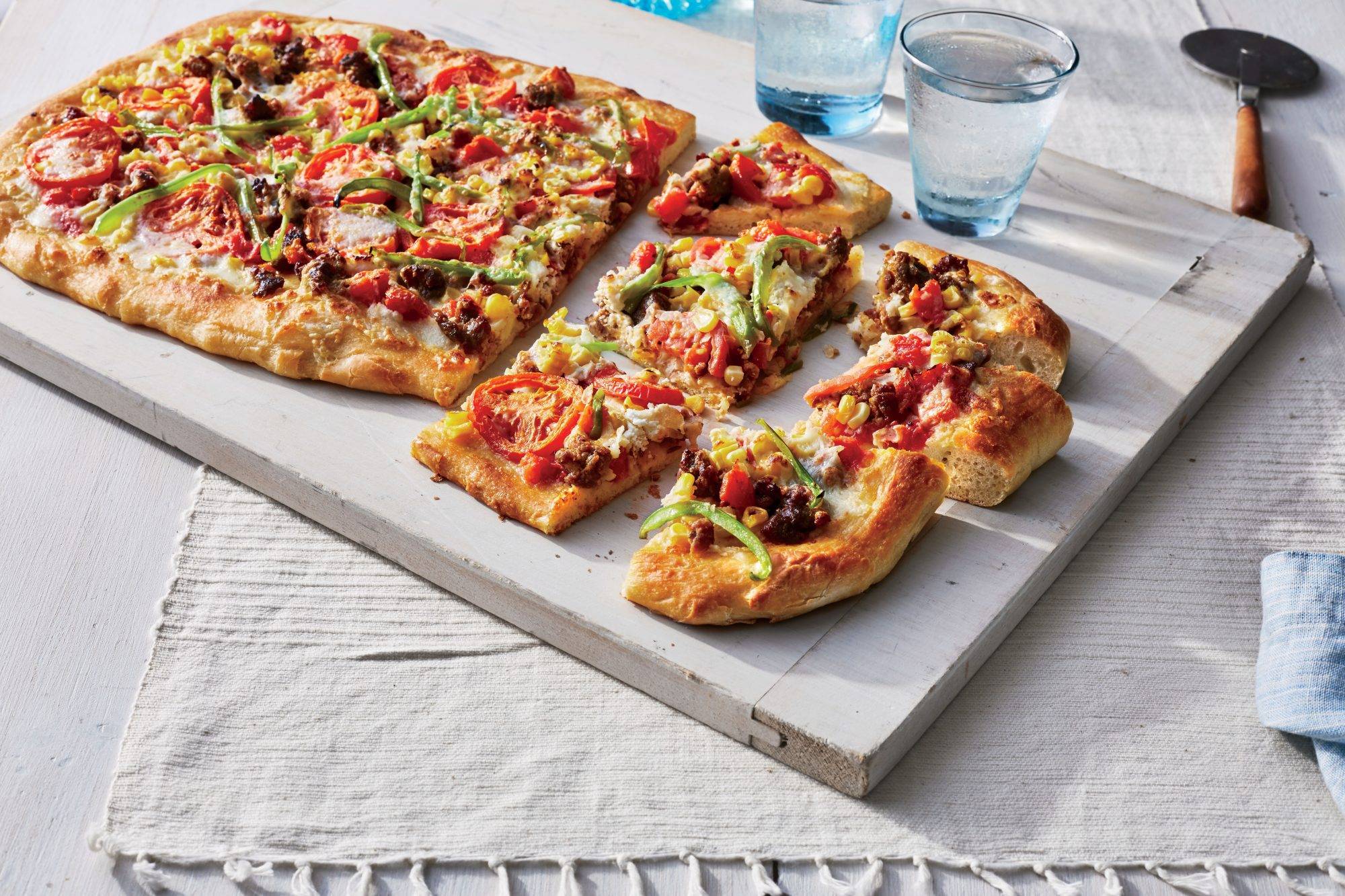 Sheet Pan Pizza with Corn, Tomatoes, and Sausage Recipe Adam Dolge