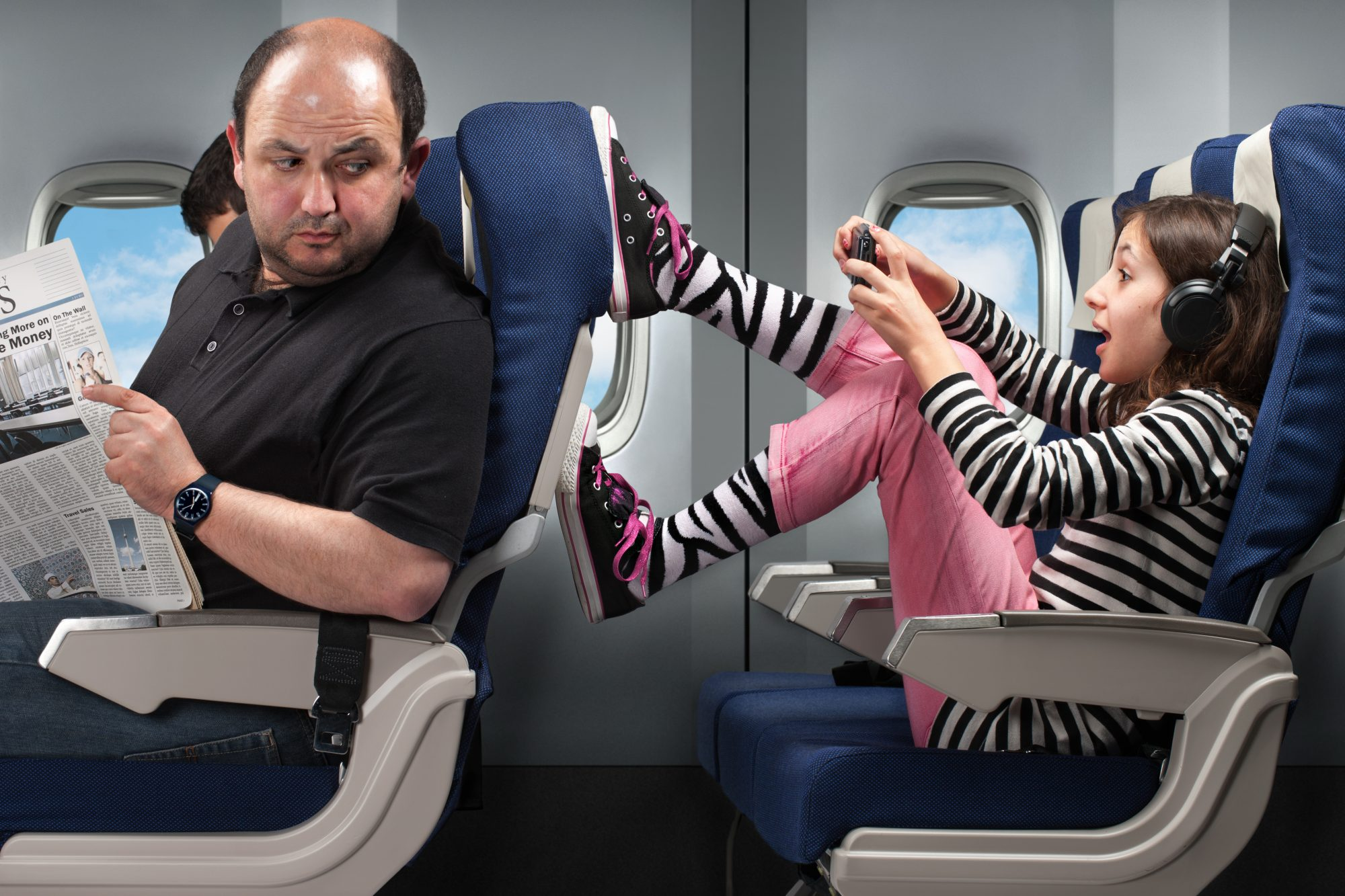 Girl with Feet Up on Airplane Seat