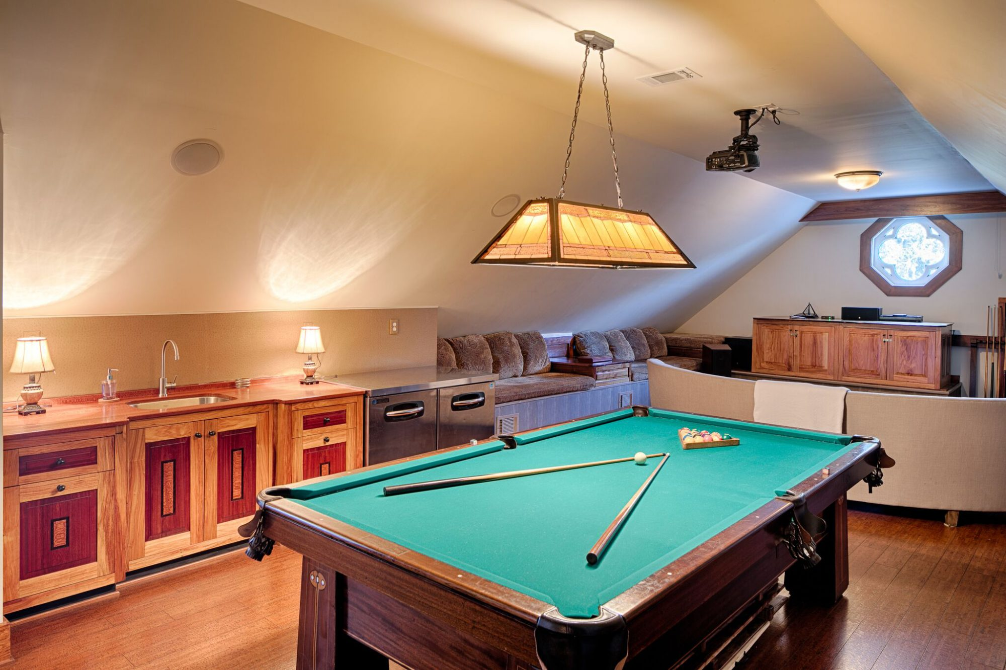 On the upper level, the billiards room has a wet bar and-of-the-art theater system. Behind the bookcase, there is also a secret passage to a hidden bedroom.