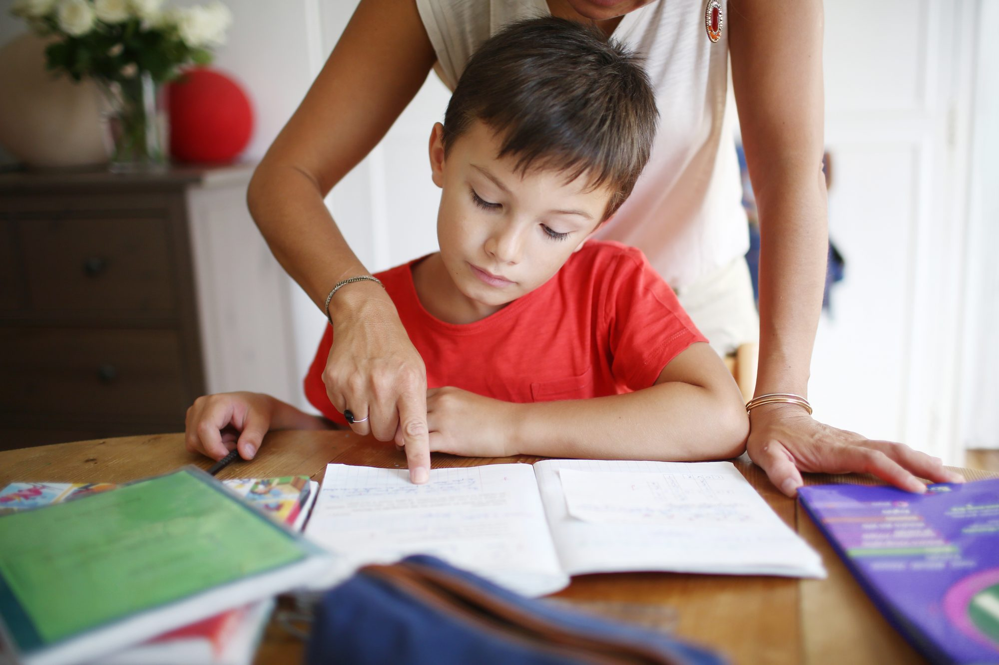 Mom Helps Boy With Homework