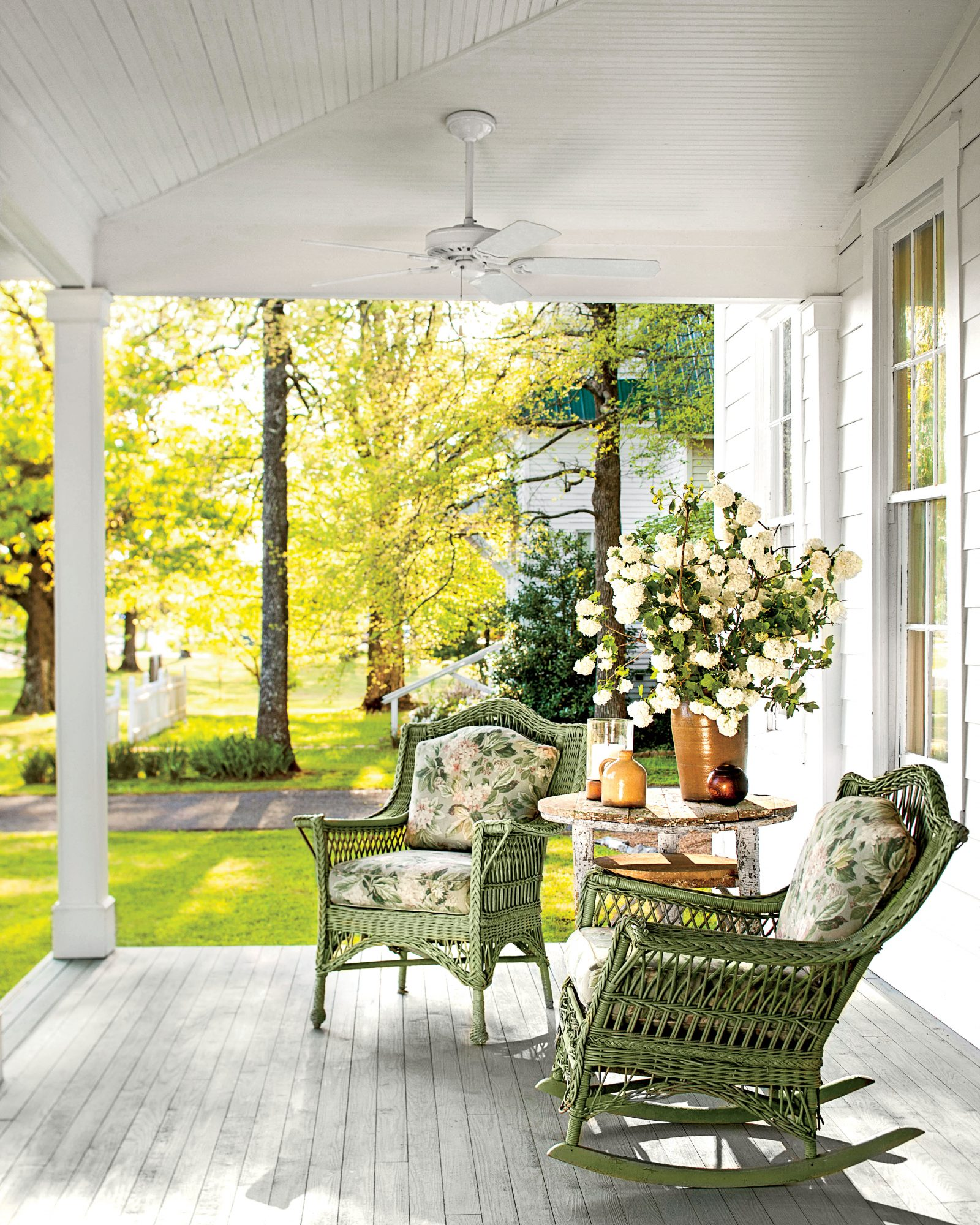 Front Porch with Green Rocking Chairs