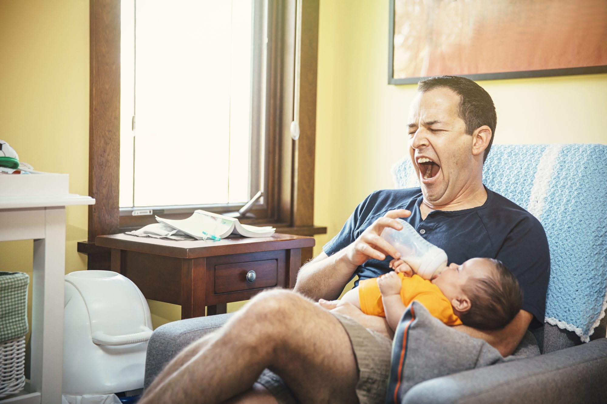 Yawning Dad and Baby