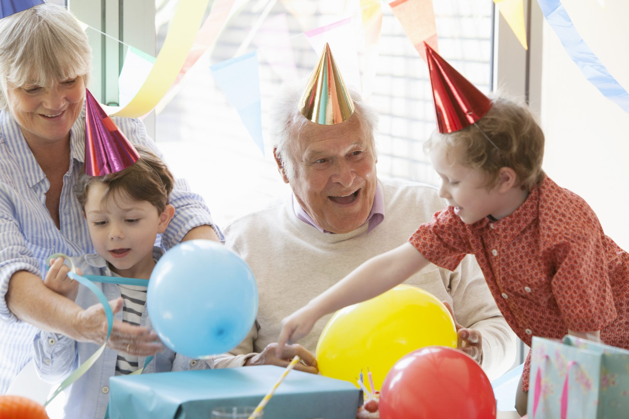 Grandfather with Children on Birthday
