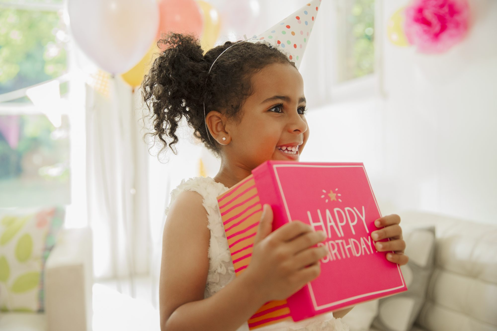 Child Holding Pink Birthday Gift Box