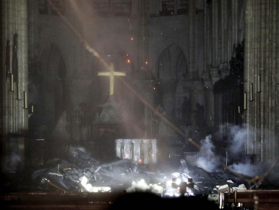 First Photos Inside Notre Dame Show Cross Shining Through the Smoke After Fire Ravages Cathedral rexfeatures_10205198bc
