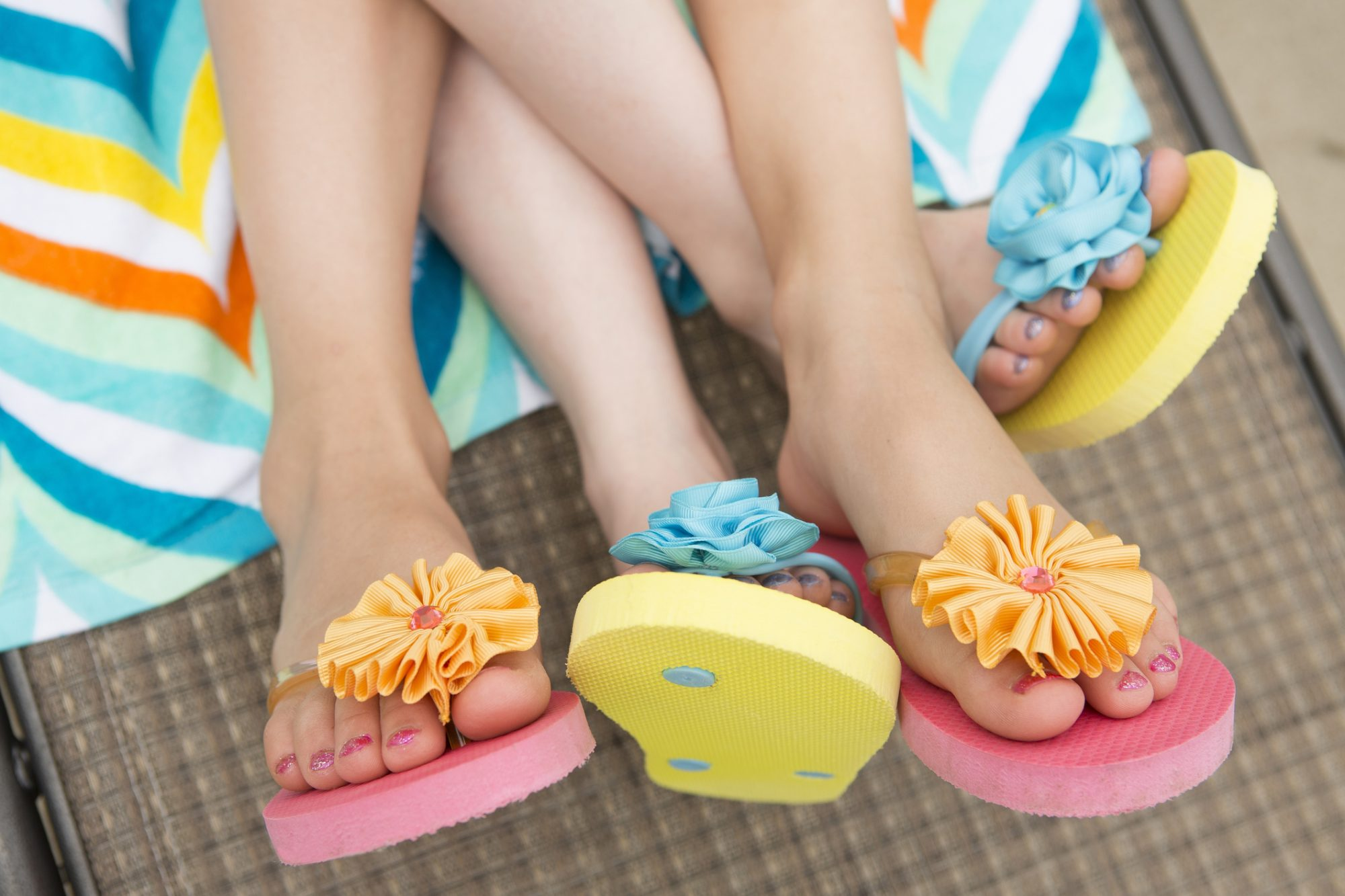 Woman and Daughter Wearing Colorful Flip Flops